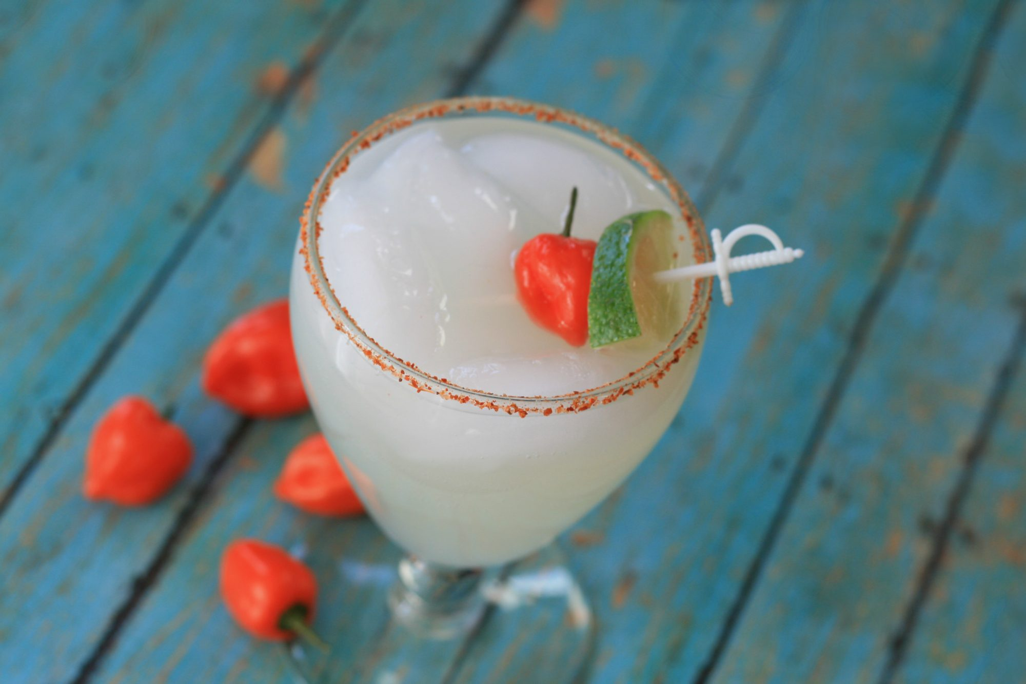 paloma cocktail with picante pepper and lime garnish