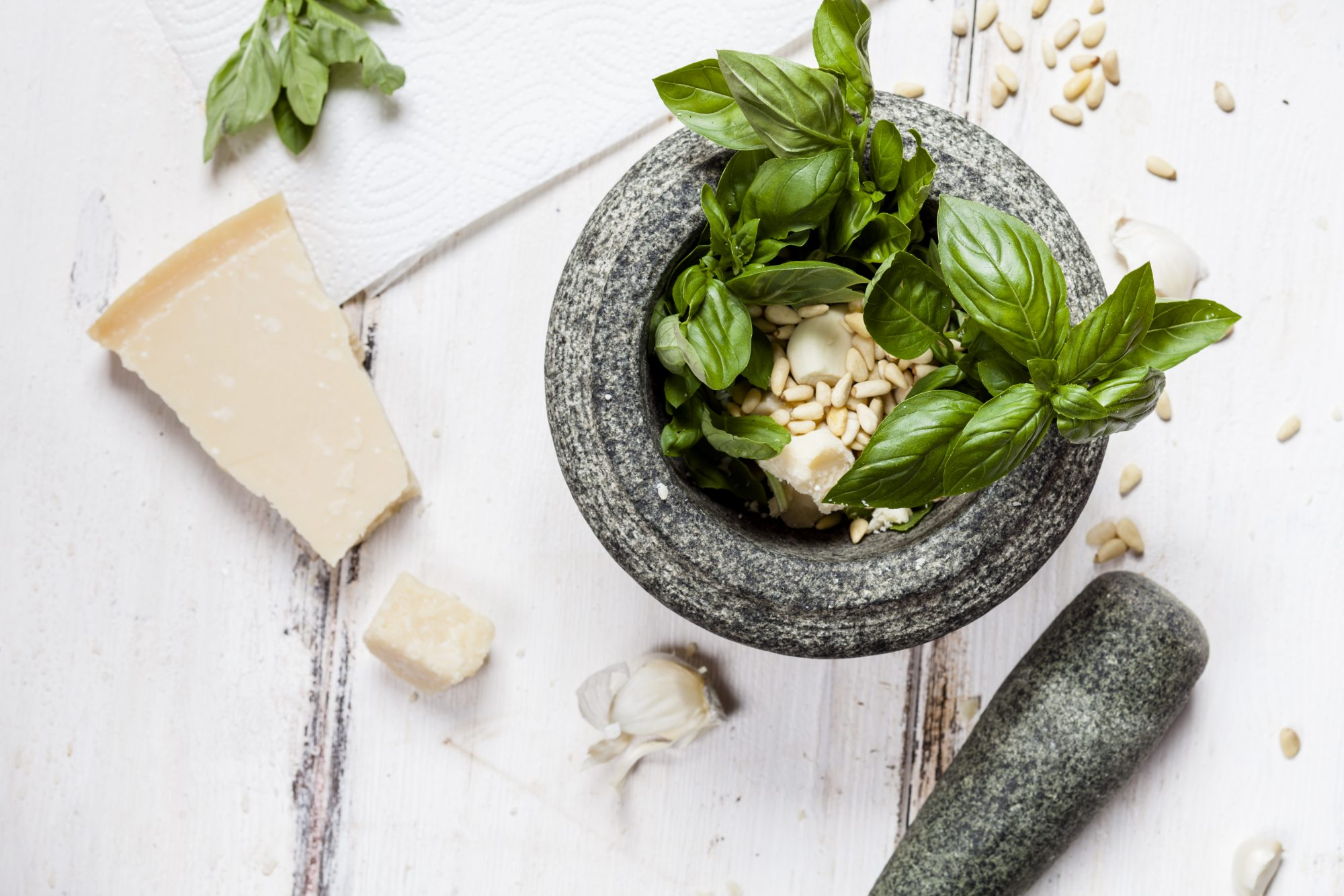 Preparing pesto alla genovese with mortar