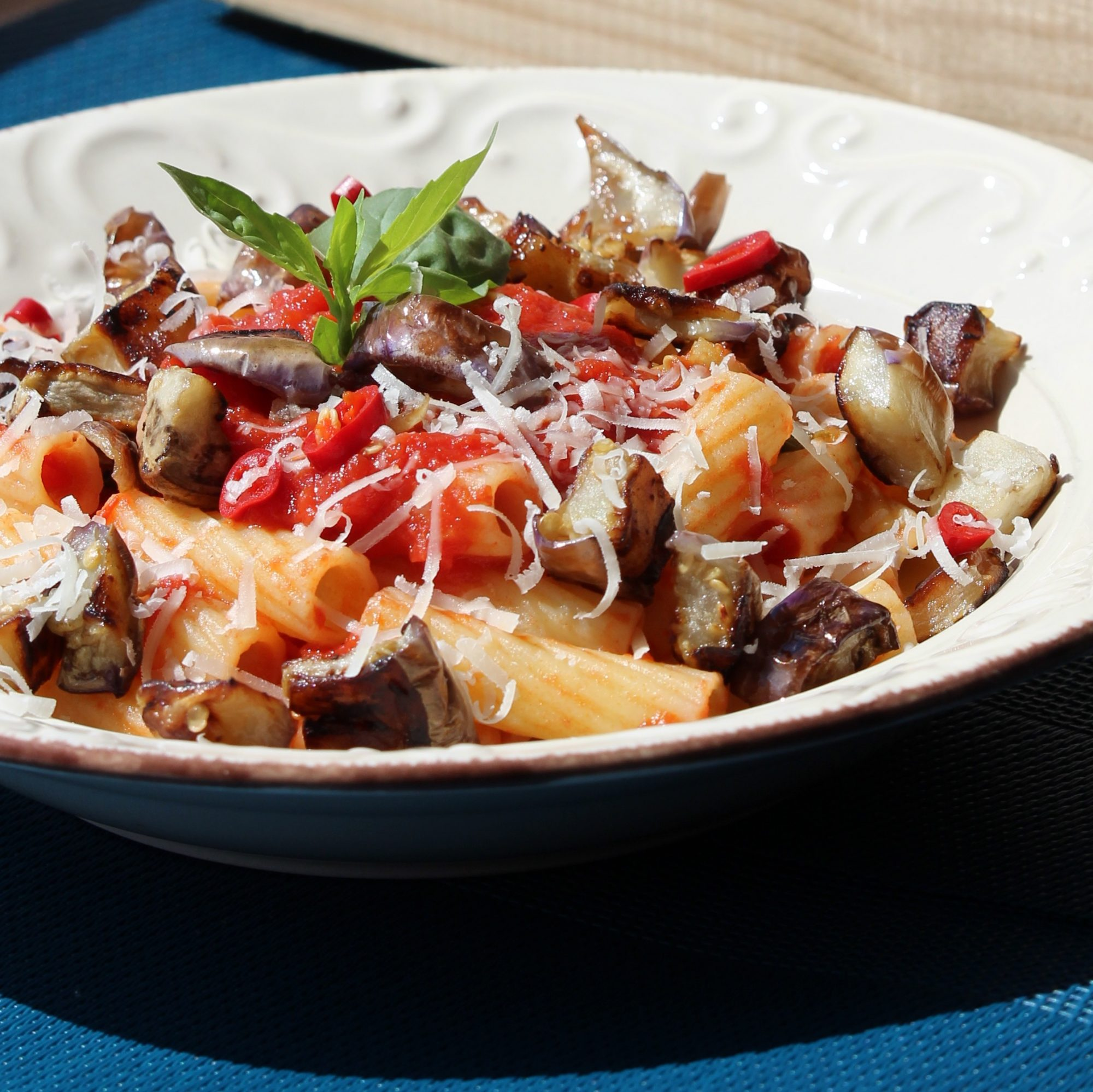 eggplant pasta with red sauce and Parmesan