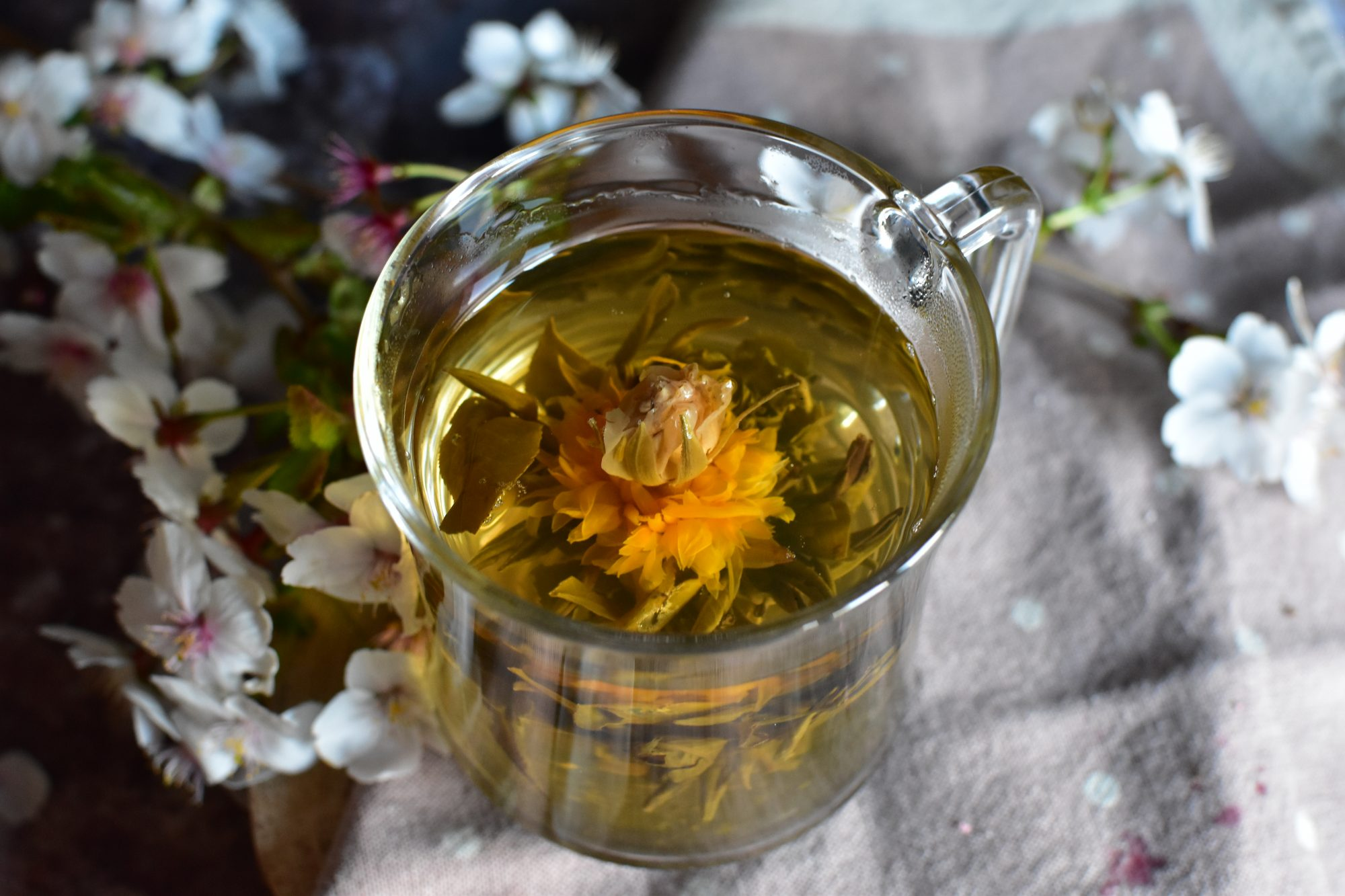 Flowering tea or blooming tea consists of a bundle of dried tea leaves wrapped around one or more dried flowers. These are made by binding tea leaves and flowers together into a bulb, then setting them to dry. When steeped, the bundle expands and unfurls in a process that emulates a blooming flower, and the flowers inside emerge as the centerpiece