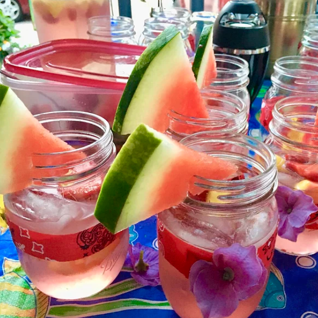 """What's the secret ingredient for this big-batch summer cocktail? A bottle of raspberry lemonade. Recipe creator Patsays it's """"easy to make and even easier to drink."""""""