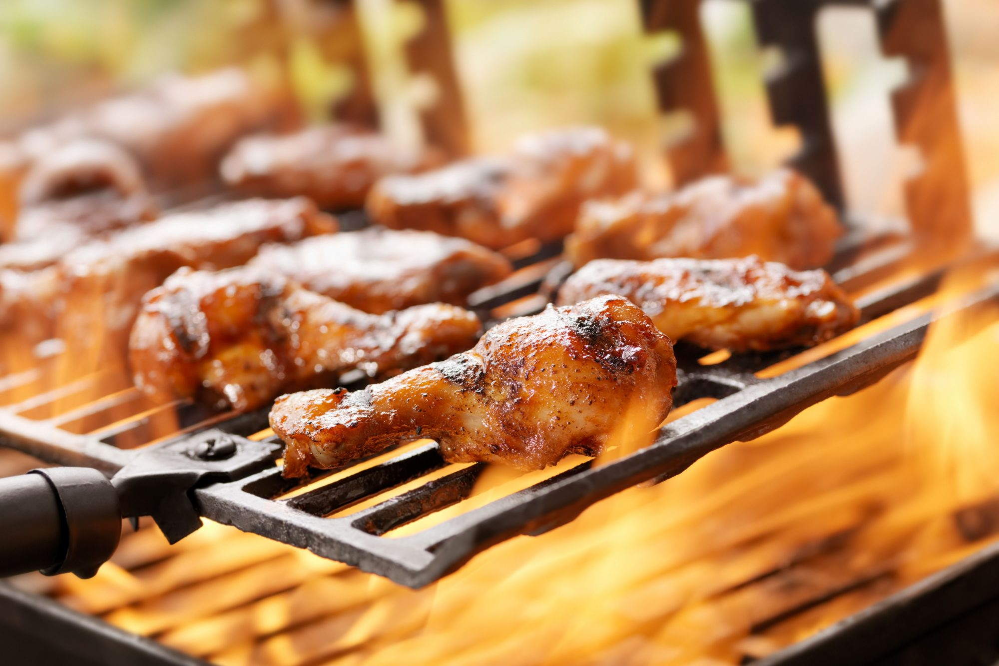 chicken wings with glaze on grill rack