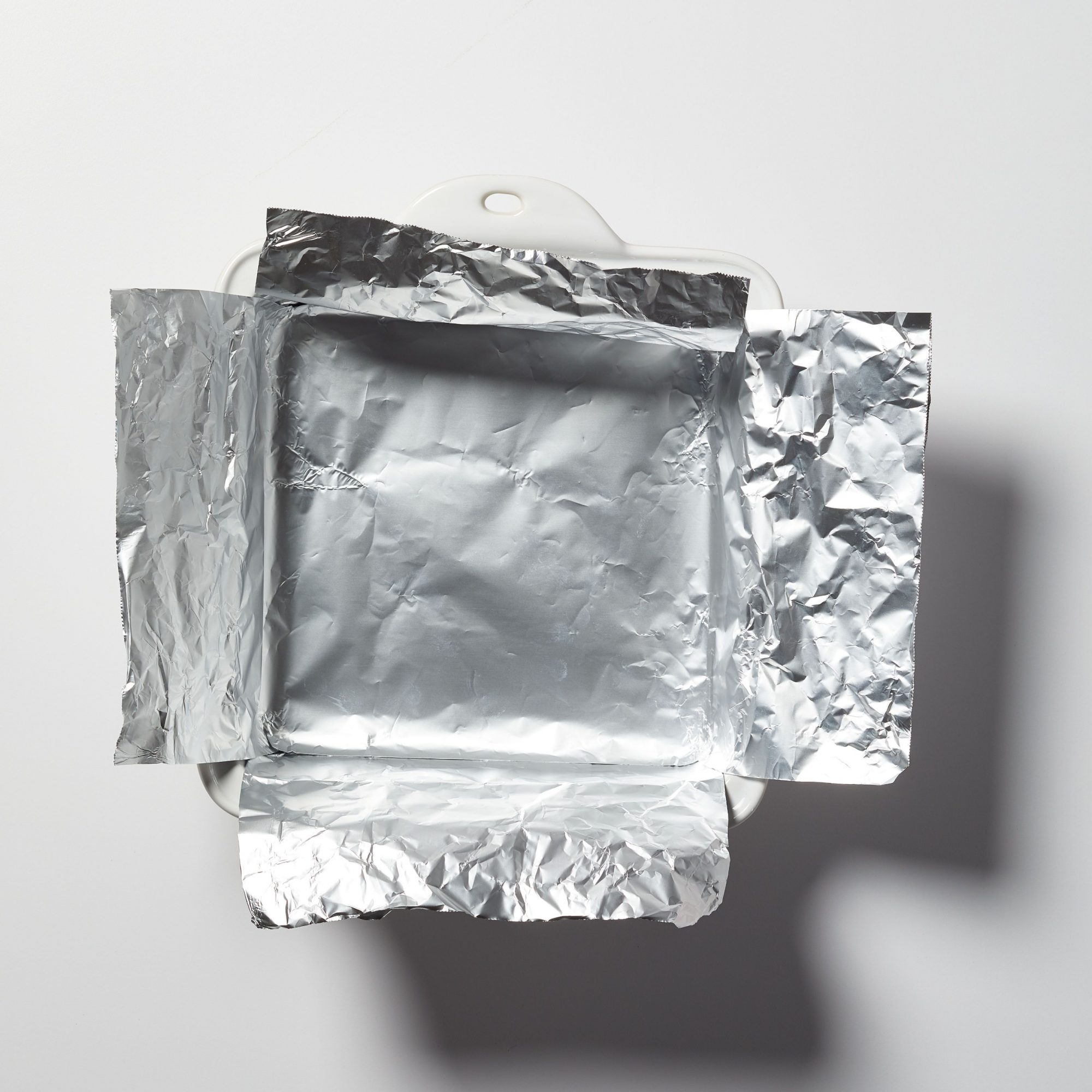 square white casserole lined with aluminum foil