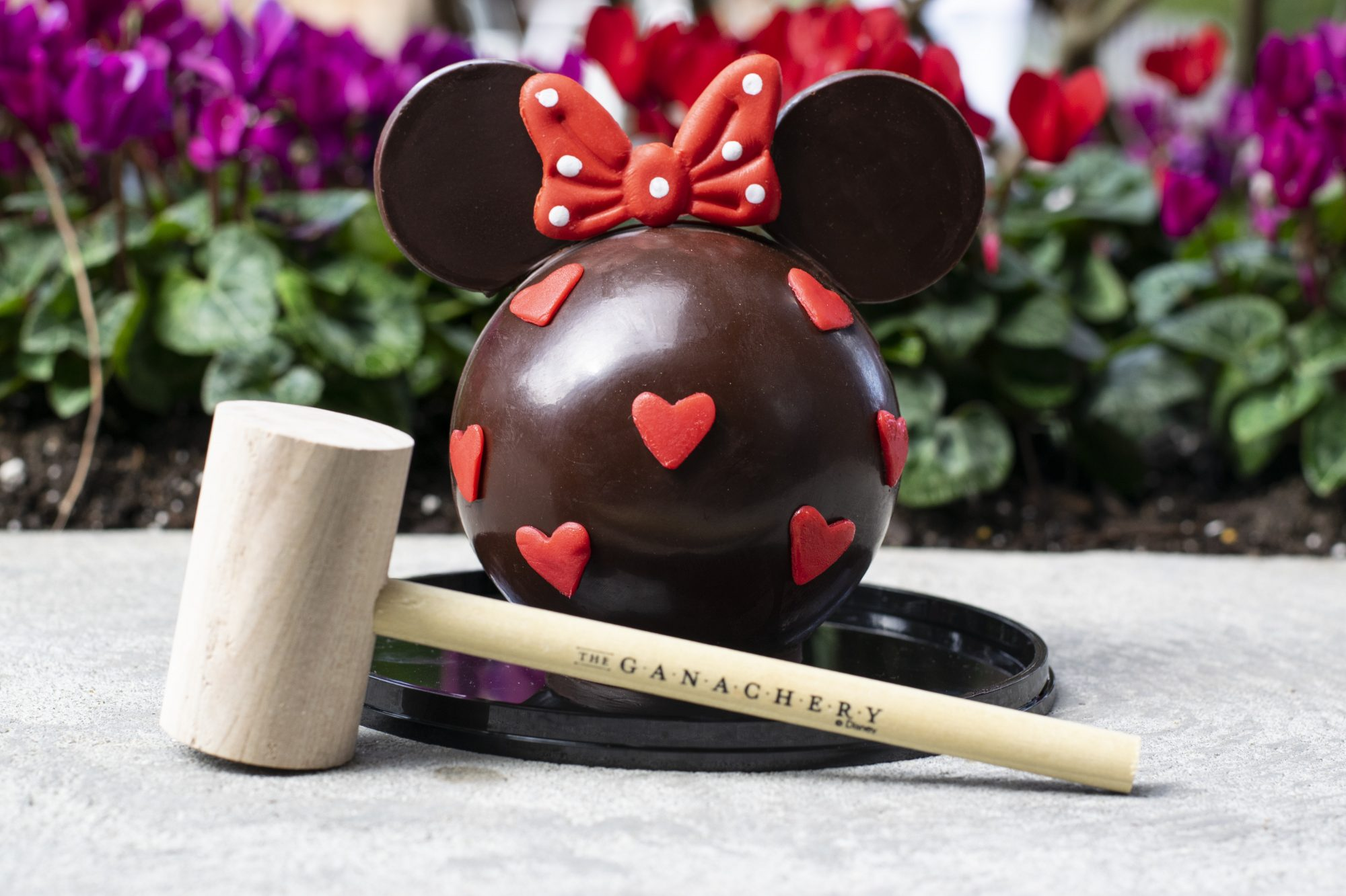 Minnie Mouse hot chocolate bomb and wooden mallet