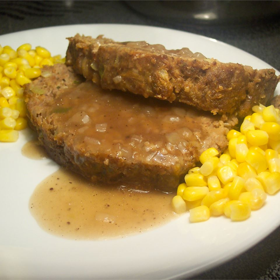 Best Ever Meatloaf with Brown Gravy on a white plate