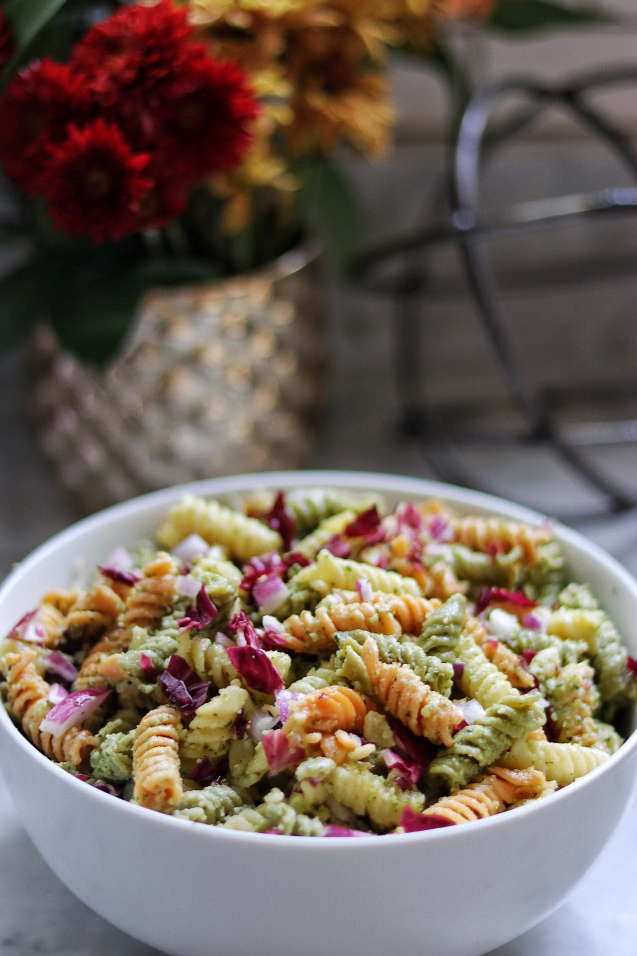 Corkscrew pasta is tossed with homemade pesto, chopped radicchio, and a bit of mayo for added creaminess. Refrigerate the salad for at least 30 minutes before serving — the flavor gets better with time.