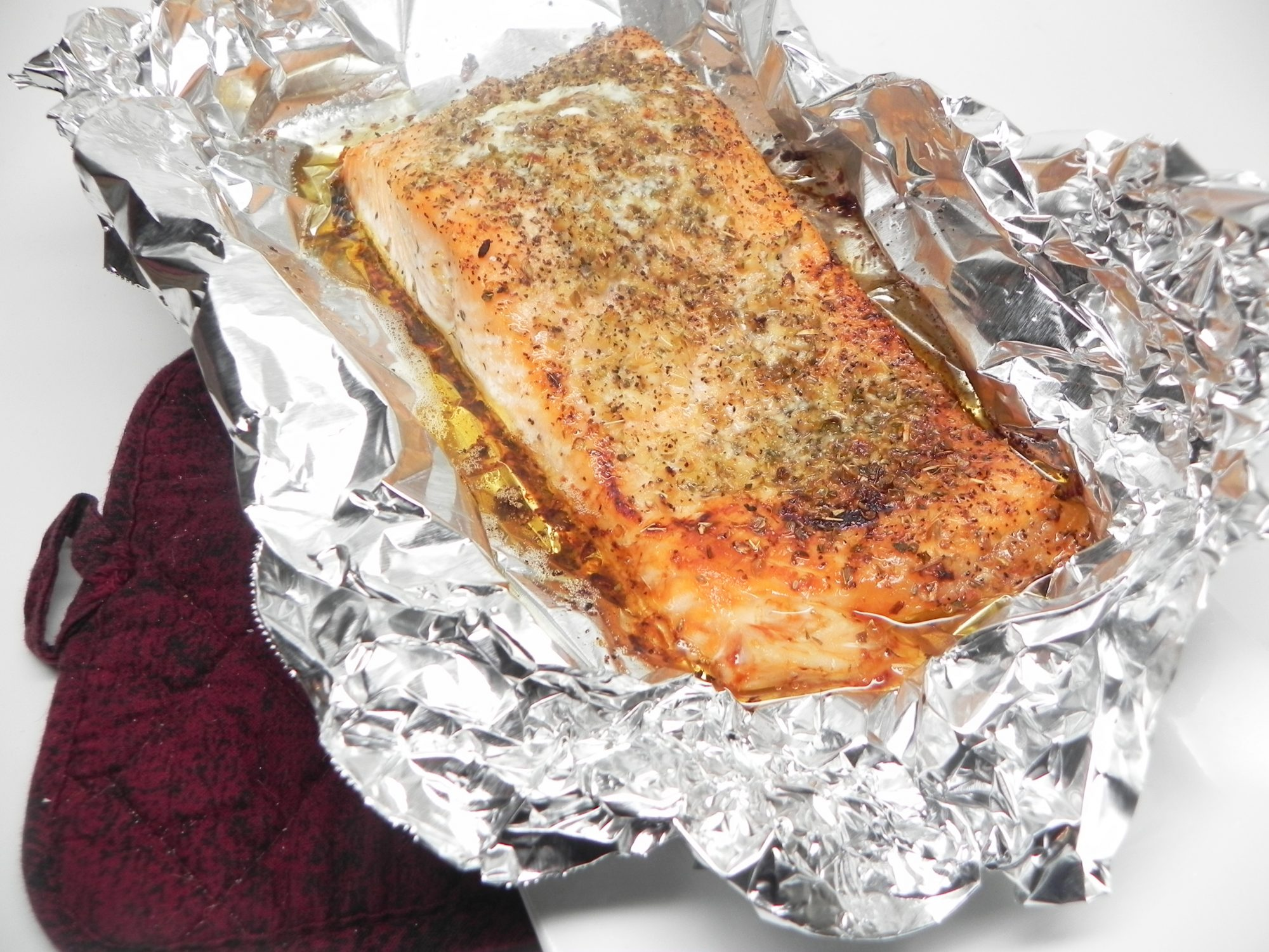 salmon with butter and garlic topping in foil