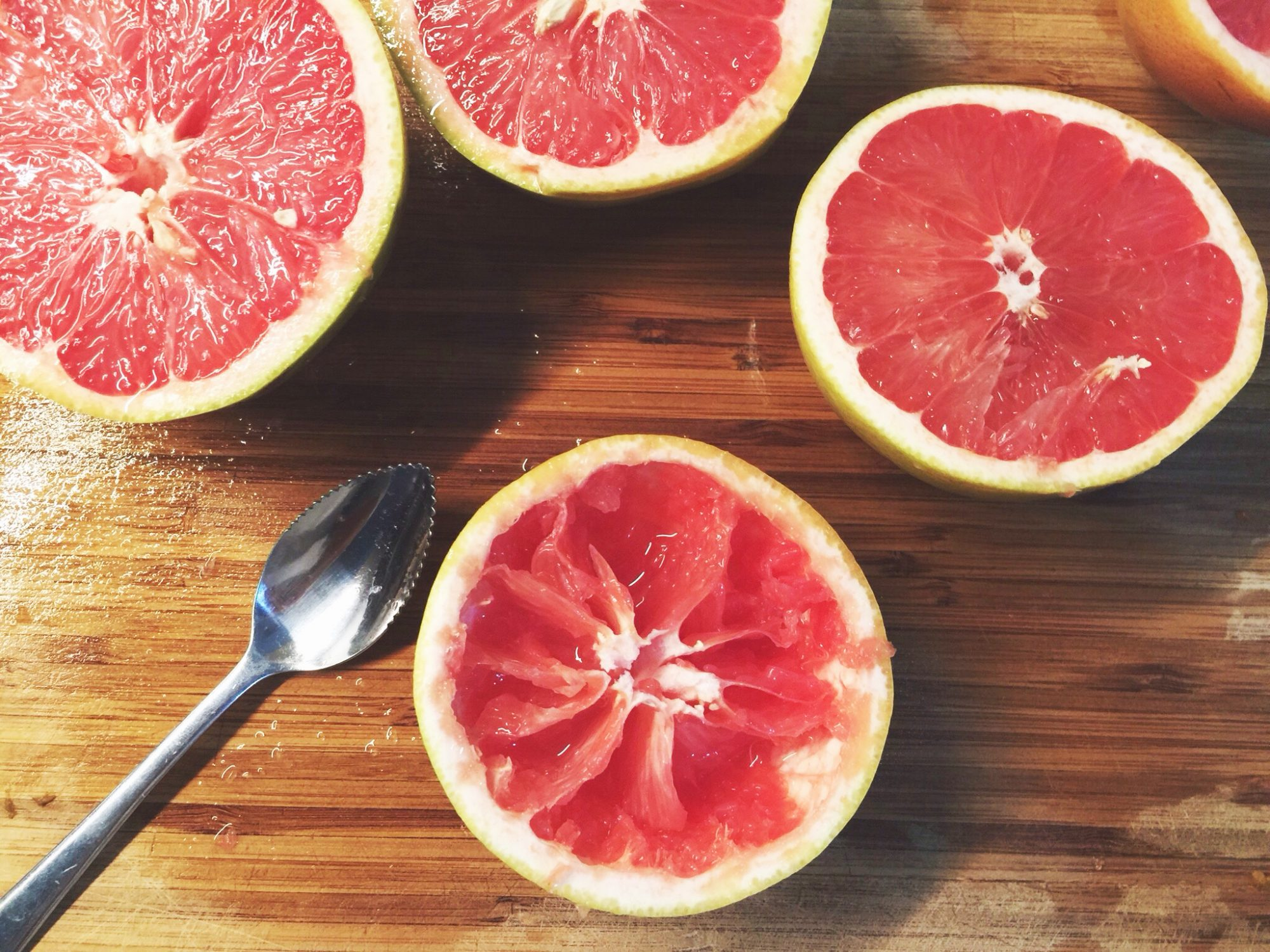 Halved Pink Grapefruit On Table
