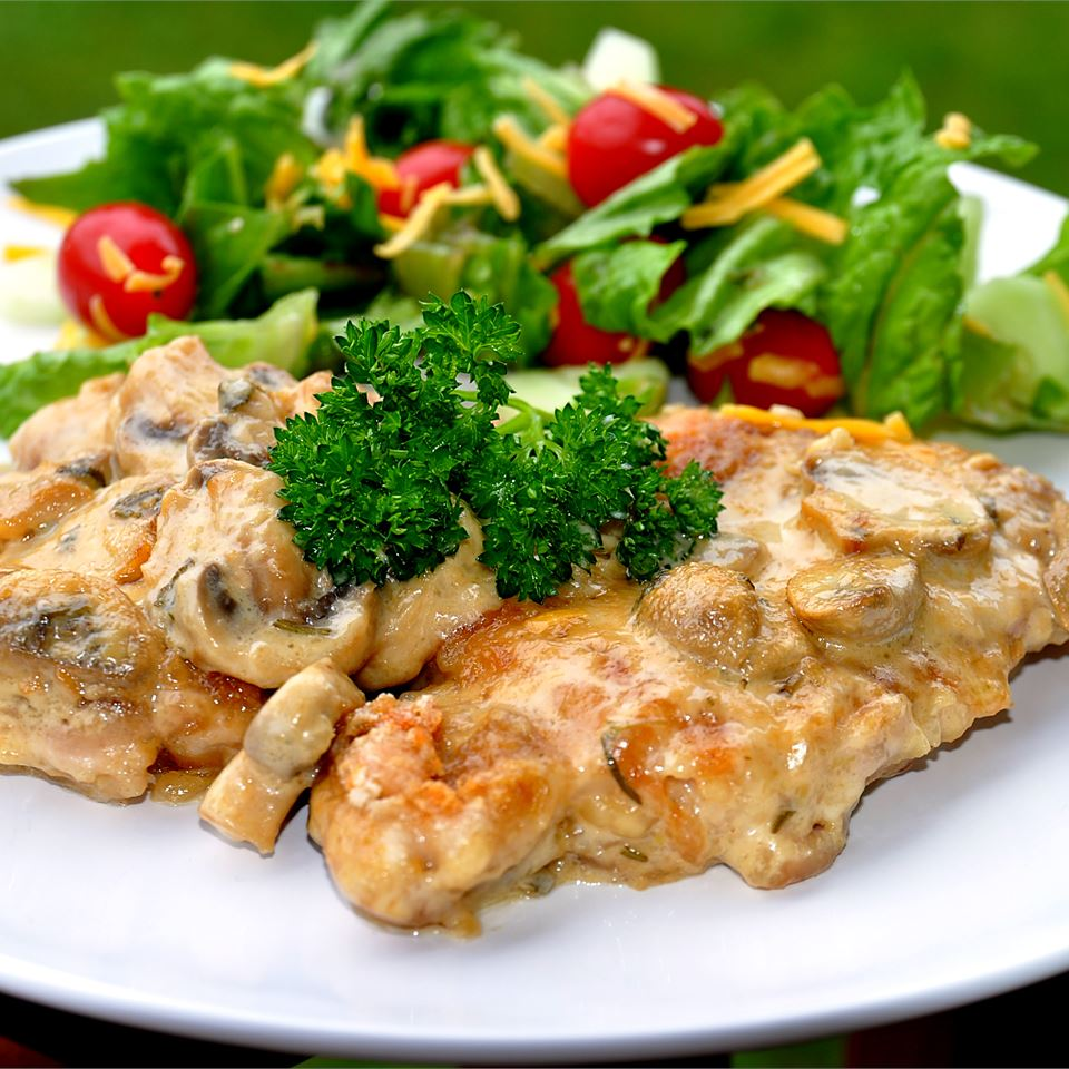 smothered chicken on white plate