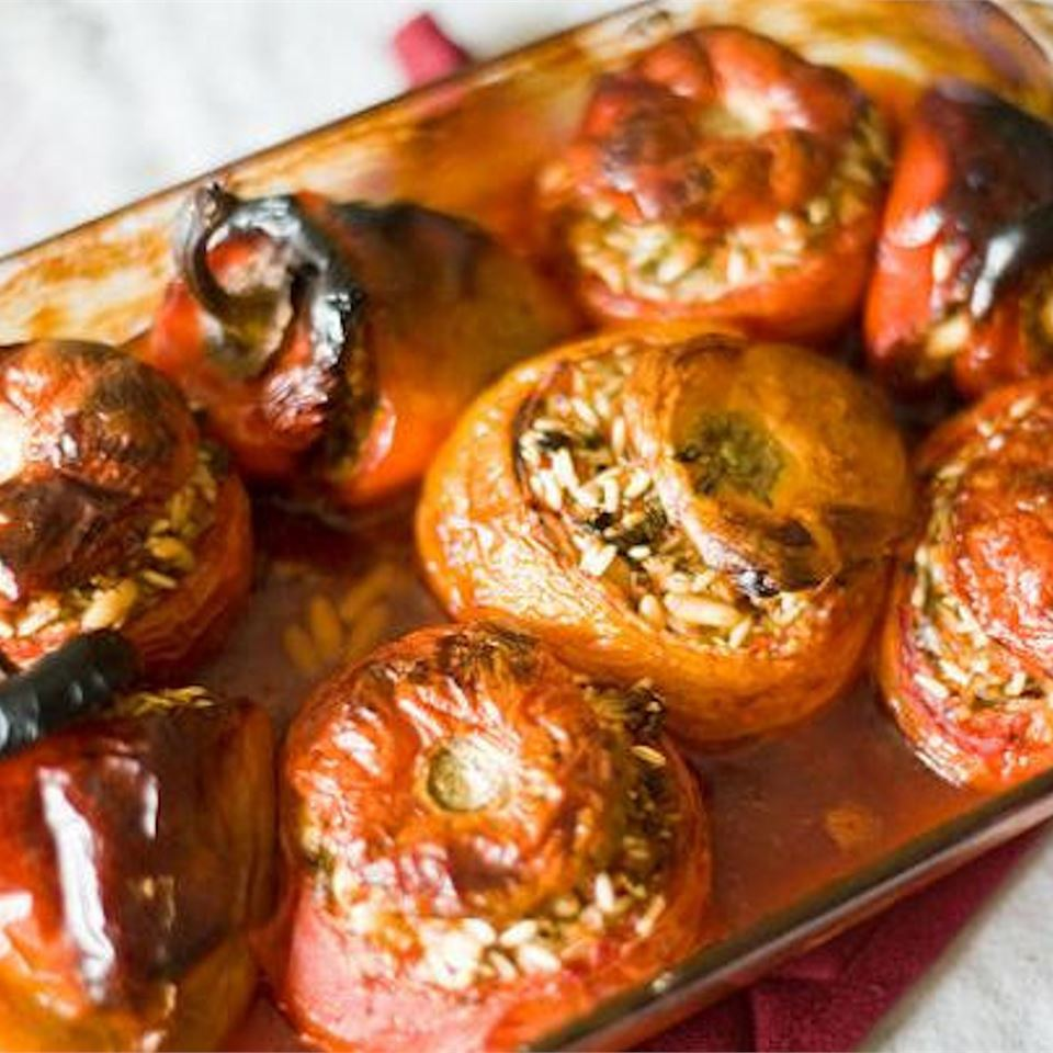 Greek Stuffed Tomatoes and Peppers in a glass dish