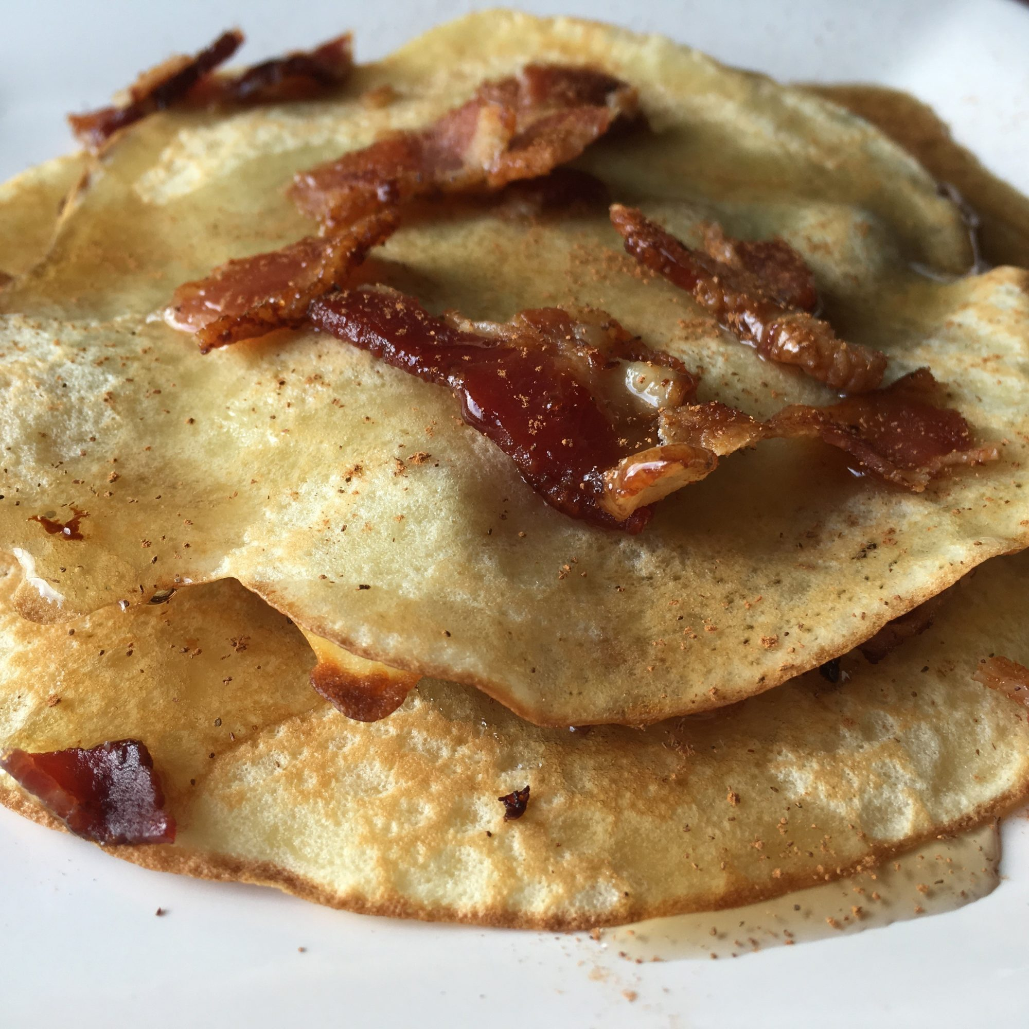Maple Bacon Crepe Stack on a white plate