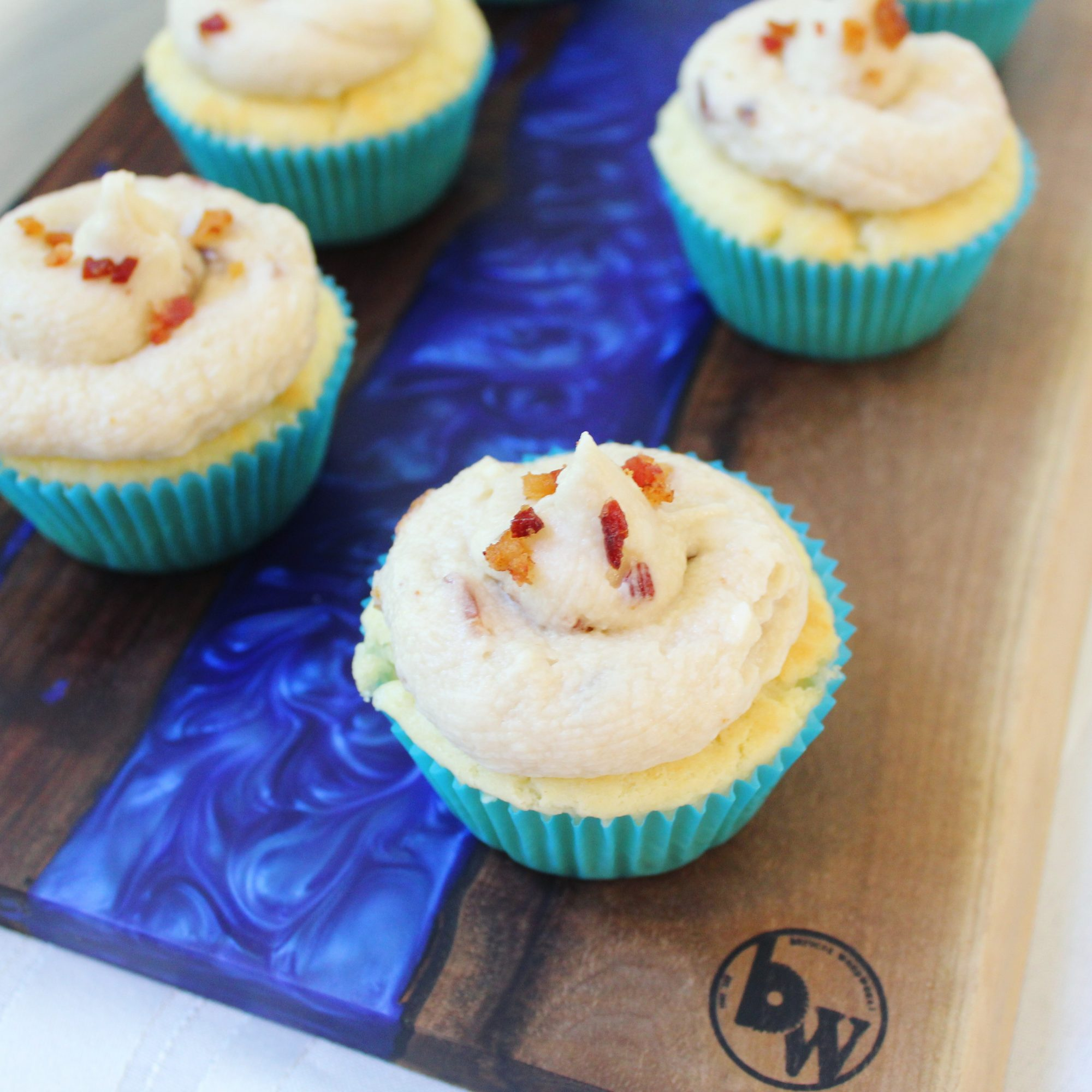 Pancake Cupcakes with Maple Bacon Buttercream Frosting on a wooden background
