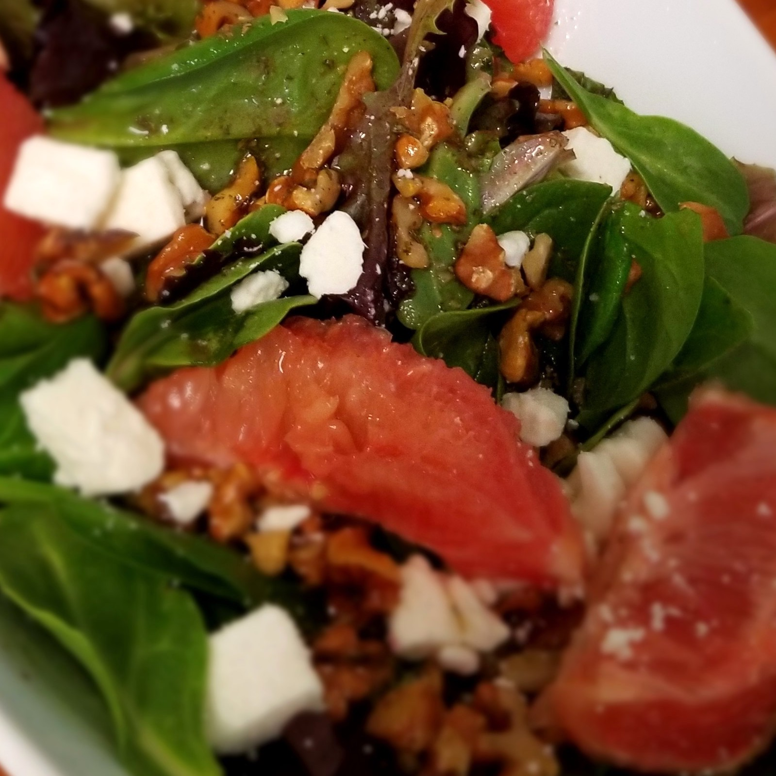 spinach salad with grapefruit, feta, chopped walnuts