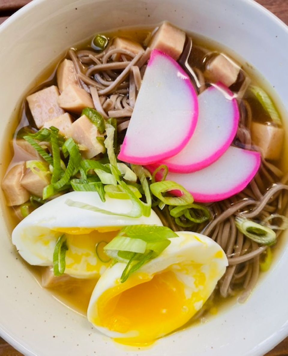 """This Hawaiian dish features soba noodles, SPAM(R), and a flavorful broth topped with soft-cooked eggs. """"Saimin is a popular Hawaiian dish that has vibes reminiscent of ramen, not surprising given the Japanese influence on food and culture in Hawaii,"""" says thymeforpineapple. """"The quick, yet flavorful broth sets the stage for this comforting soup."""""""