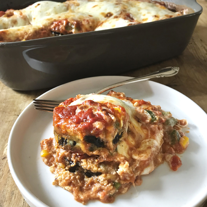 A plate of Meatless Eggplant Lasagna with casserole in background.
