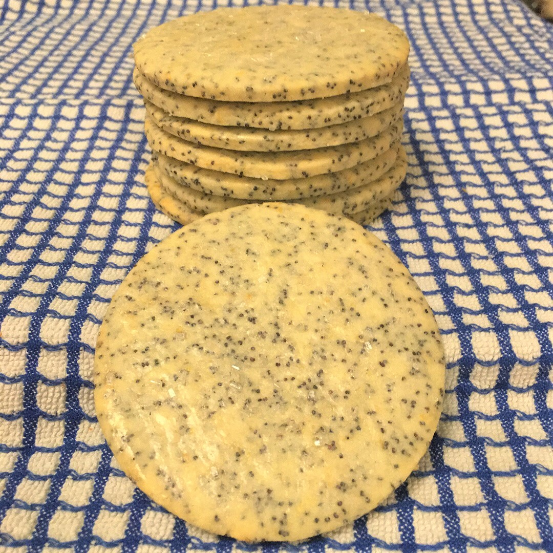 a stack of munn cookies, flavored with lemon and poppy seeds