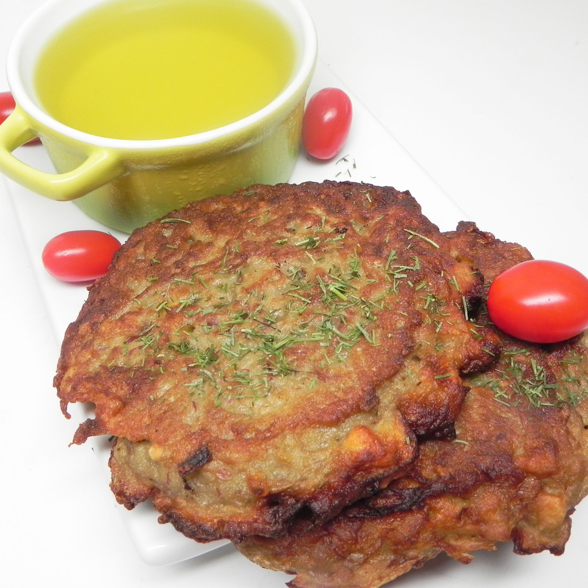 Potato Pancakes with Pickle Juice on a white background