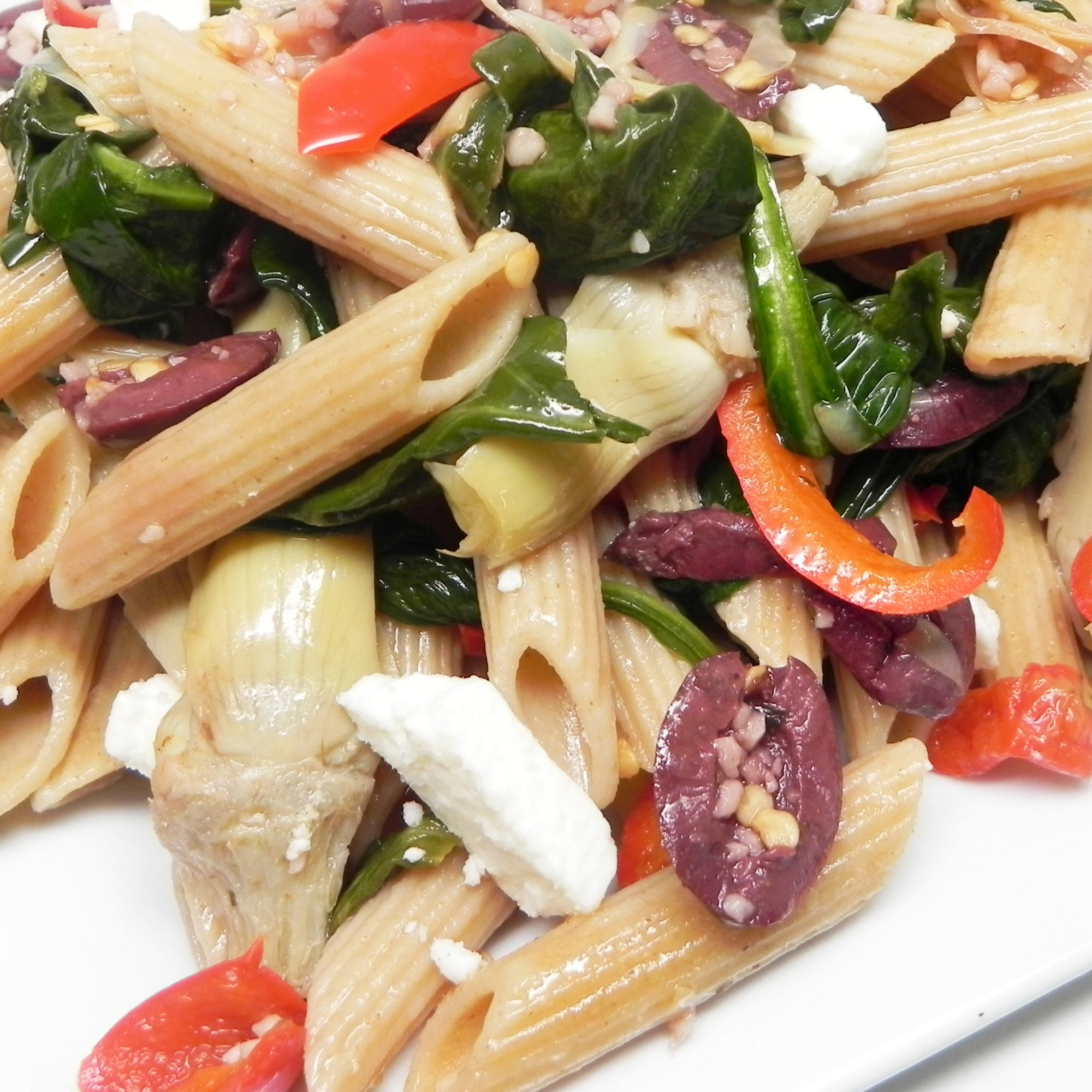 whole wheat pasta with feta, olives, peppers, spinach
