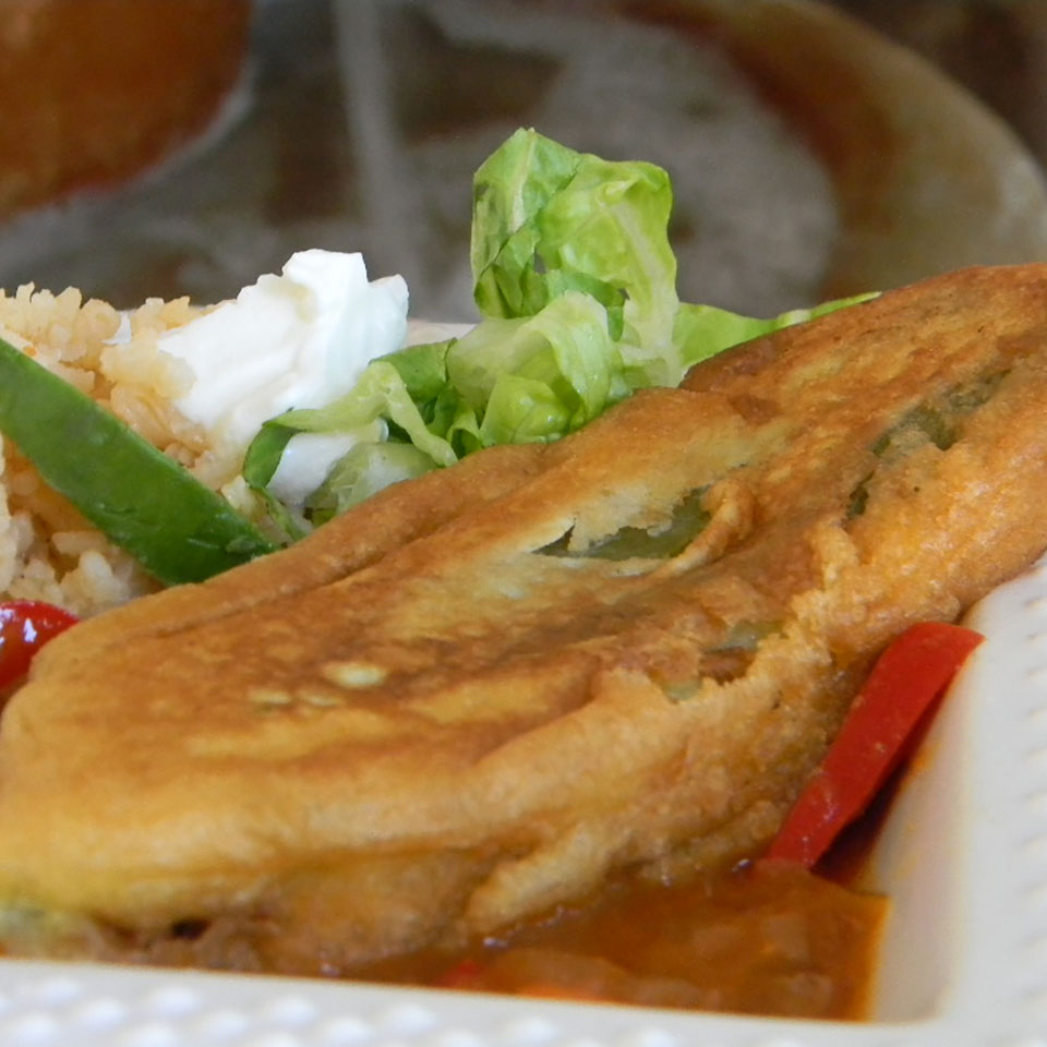 Authentic Mexican Chili Rellenos on a white plate