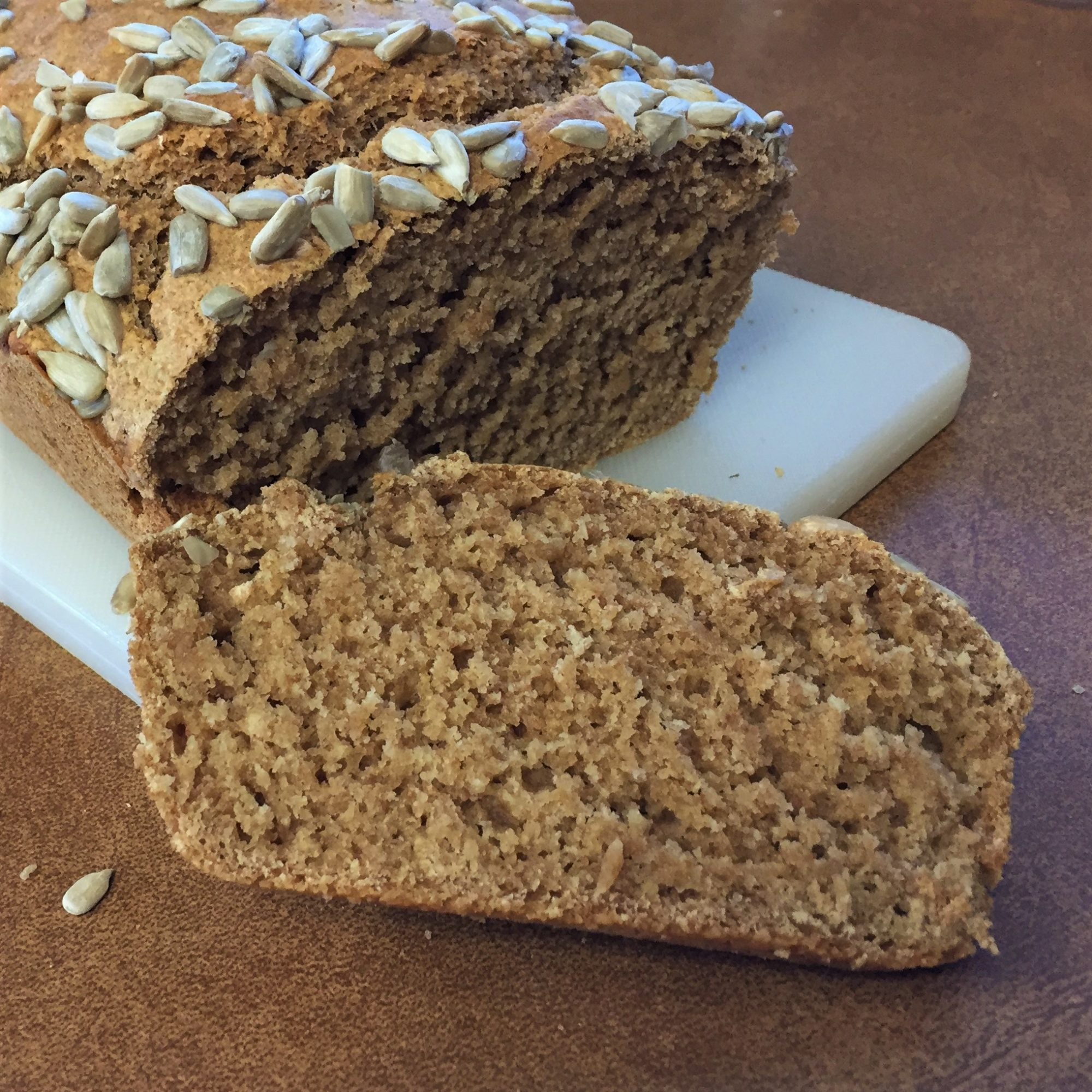 beer bread with one slice cut in the foreground
