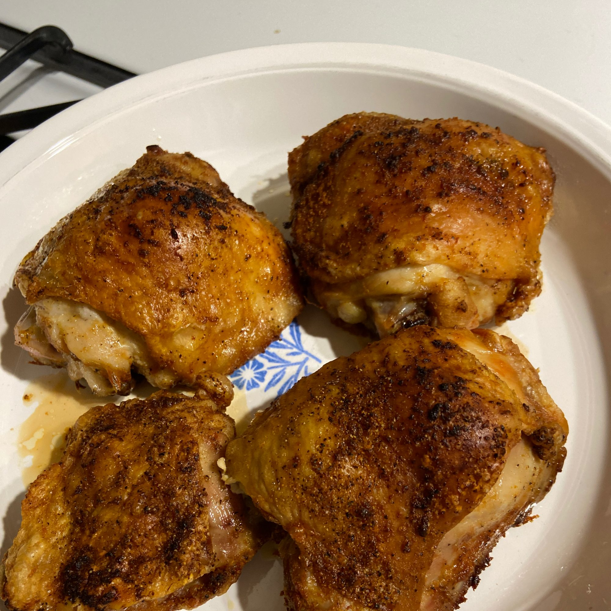 Air Fryer Chicken Thighs on a white plate