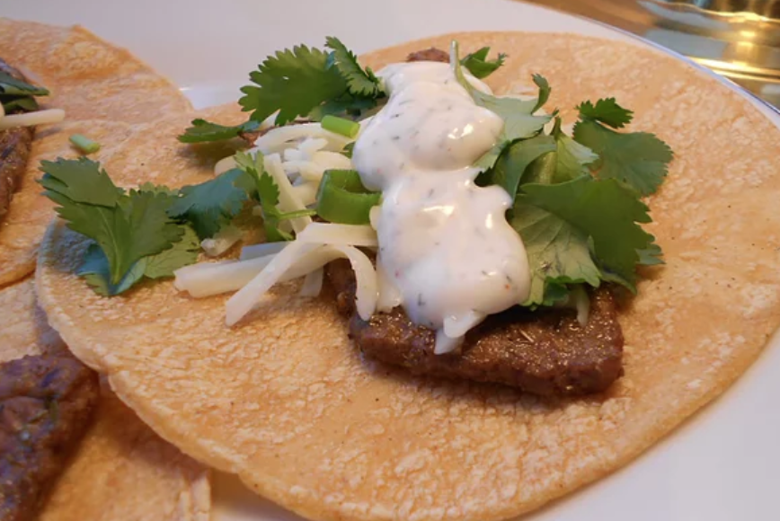 A creamy mayonnaise-yogurt sauce (flavored with cayenne pepper, dill weed, cilantro, lime juice, and salt) is the perfect finishing touch for these steak tacos.
