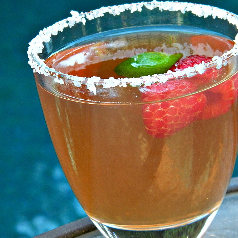 margarita with raspberries and lime and salt rim