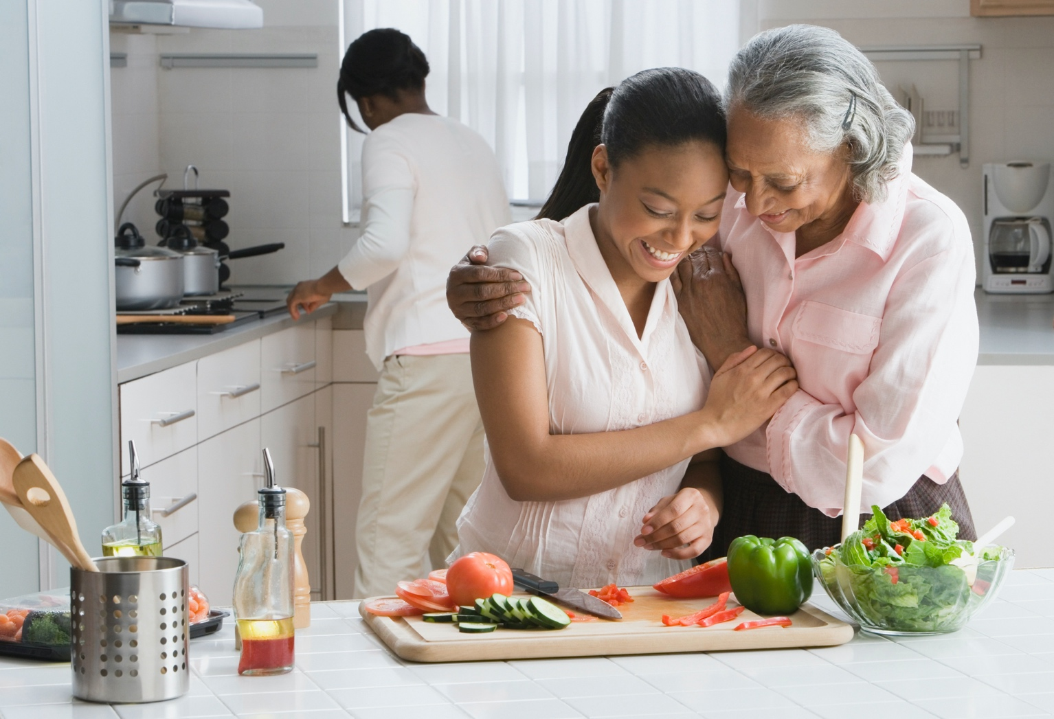 grandmother and granddaughter at the kitchen counter preparing food