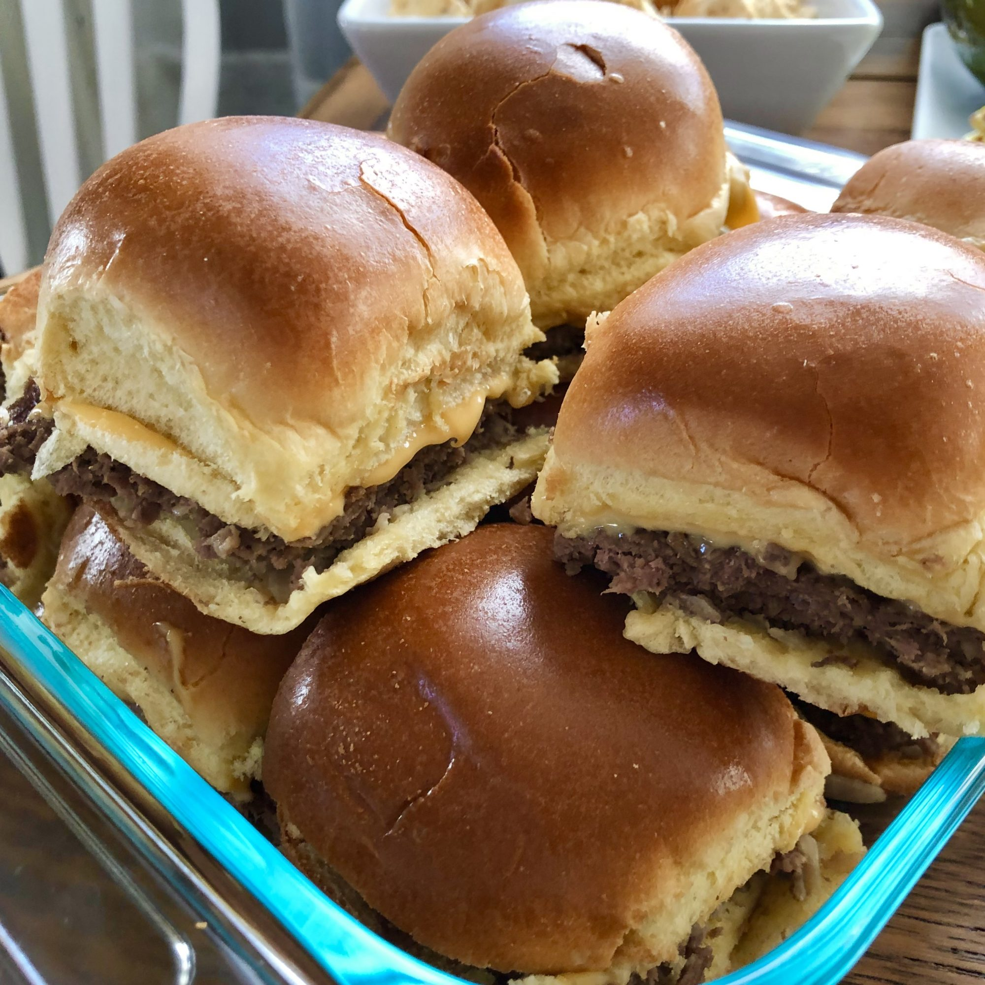 Got a craving for sliders? You'll recognize the style of these ground beef patties from their drive-thru inspiration. You can keep it simple with American cheese, dill pickle, and mustard, or fix it up with as many toppings as you want.