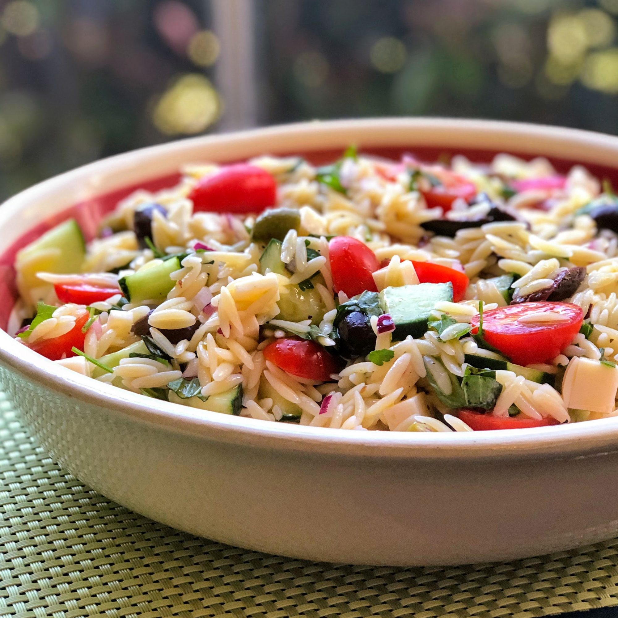 orzo salad with tomatoes, cucumbers, cheese cubes
