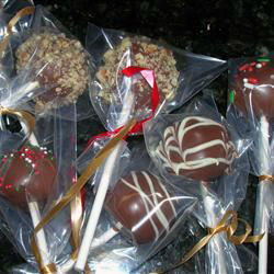 decorated brownie balls individually wrapped in plastic bags with gift ribbon