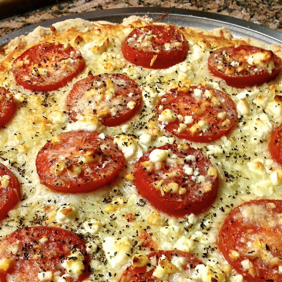 Four Cheese Margherita Pizza on a baking sheet
