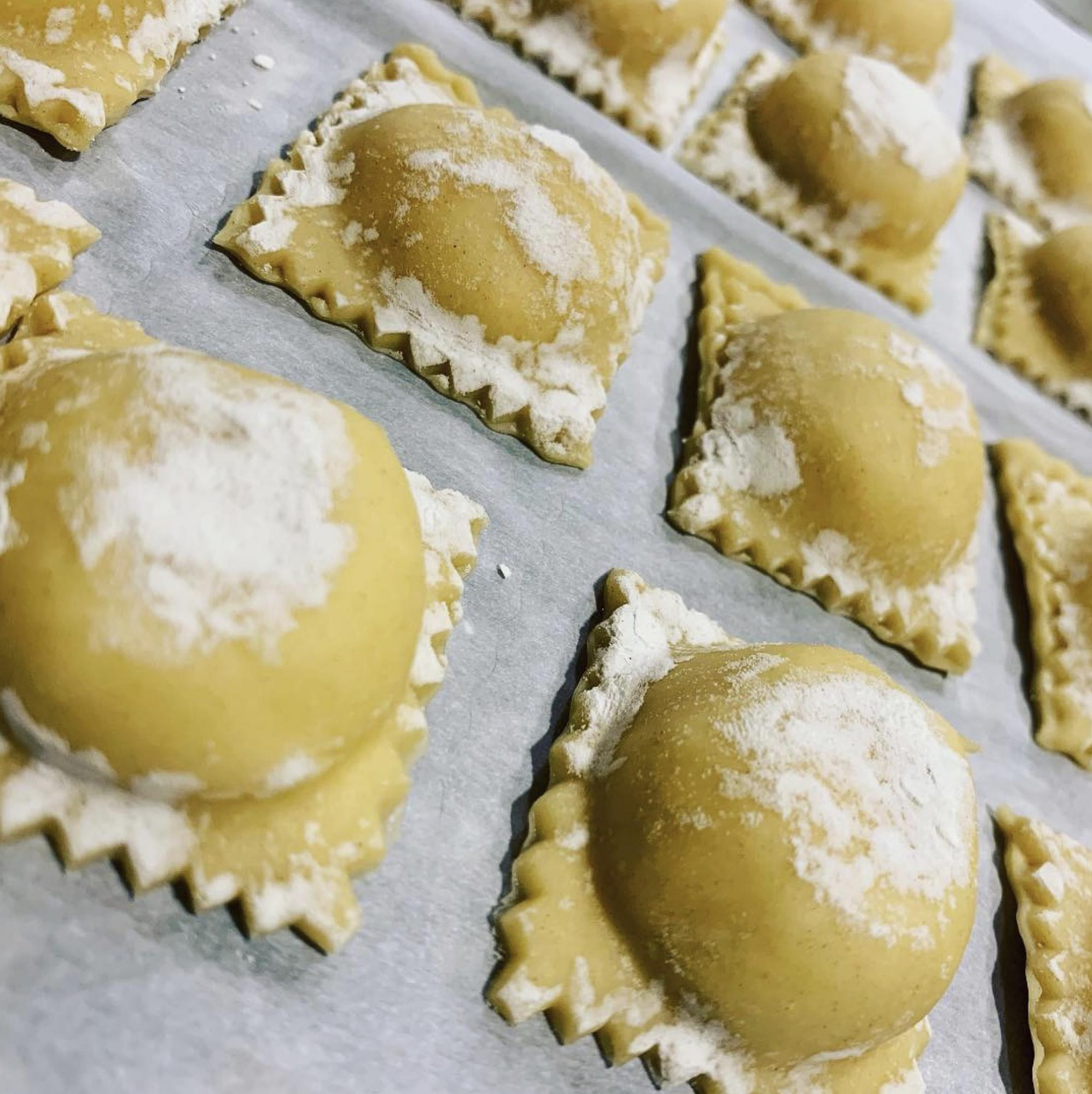 Making your own ravioli pasta from scratch does take time, but this recipe is well worth it. The filling is made with ricotta, cream cheese, mozzarella, and provolone. Serve with marinara sauce and top with a rich pesto cream for a restaurant-worthy appetizer.