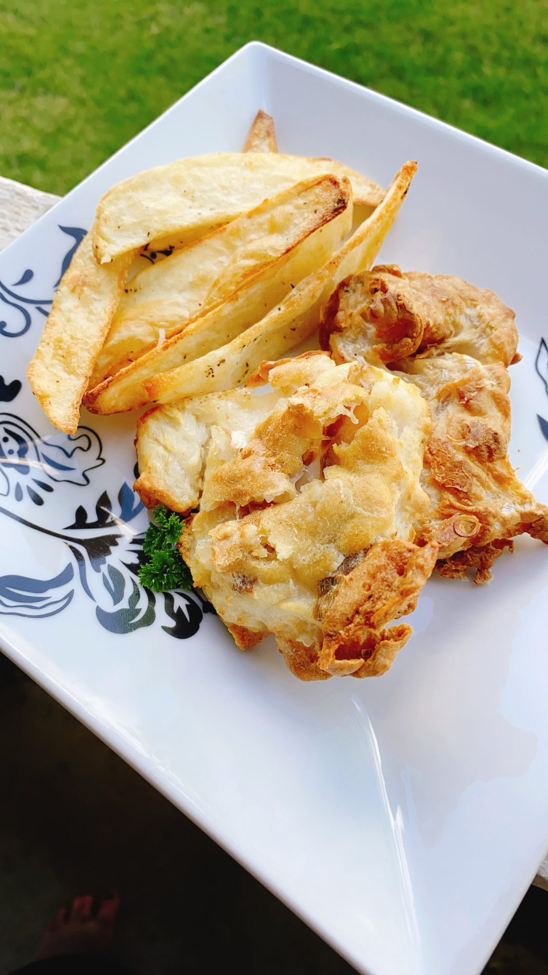 air fried cod and fries on white plate