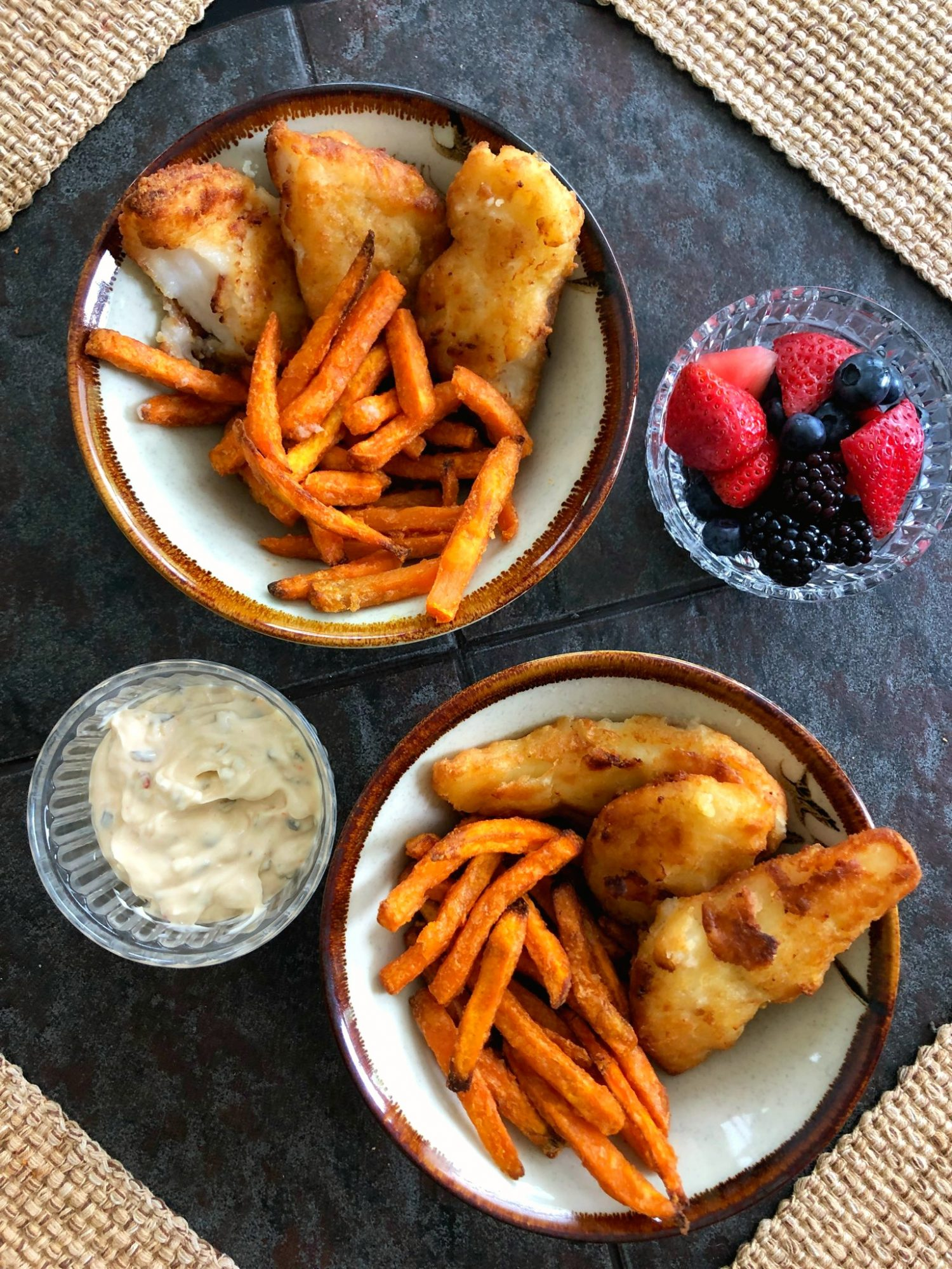 fried cod with sweet potato fries in bowls