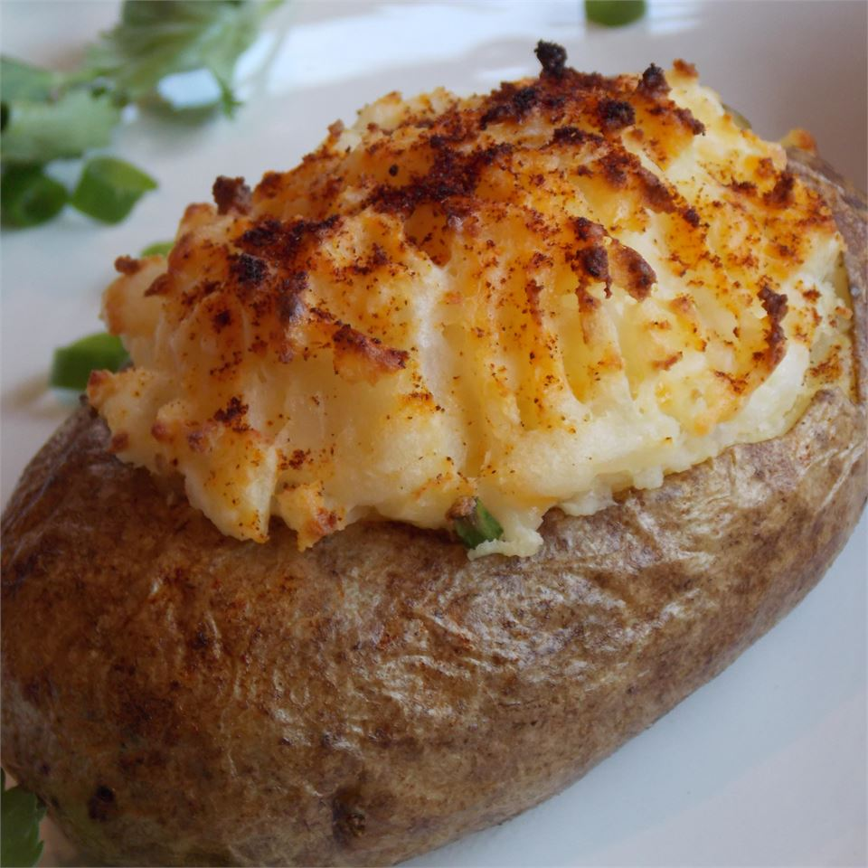 closeup of a twice-baked potato with a crispy-looking browned top
