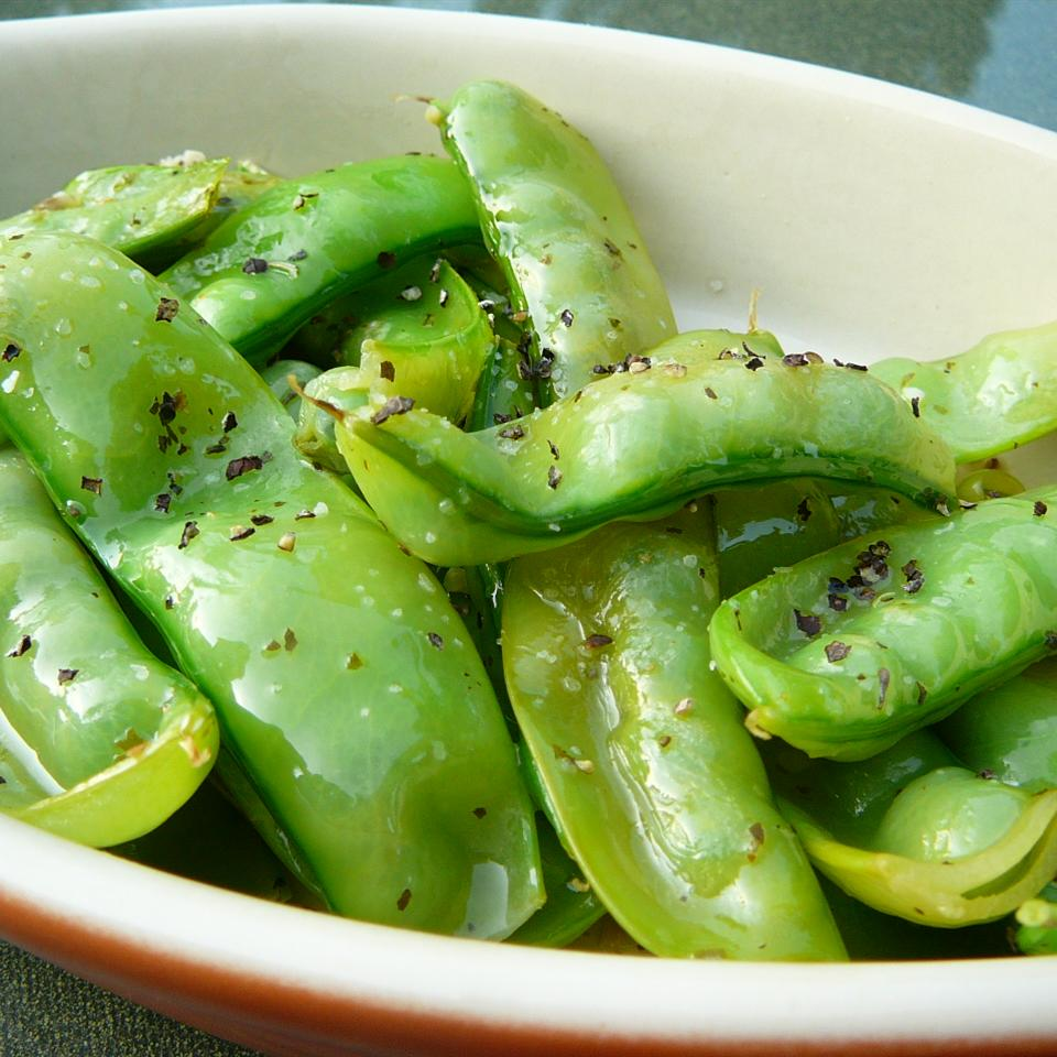 bowl of fresh snow peas sauteed in olive oil
