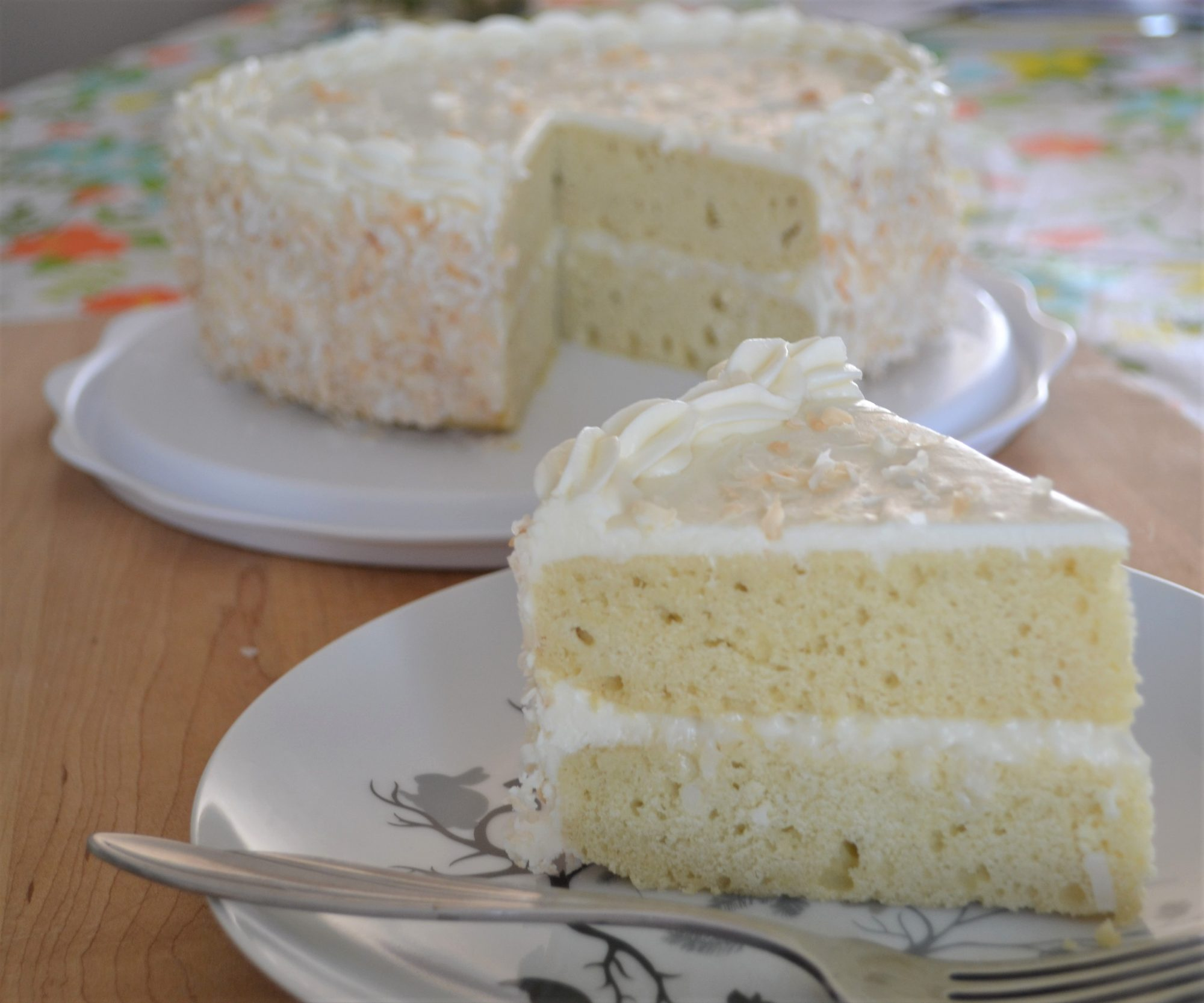 classic coconut cake with plated slice