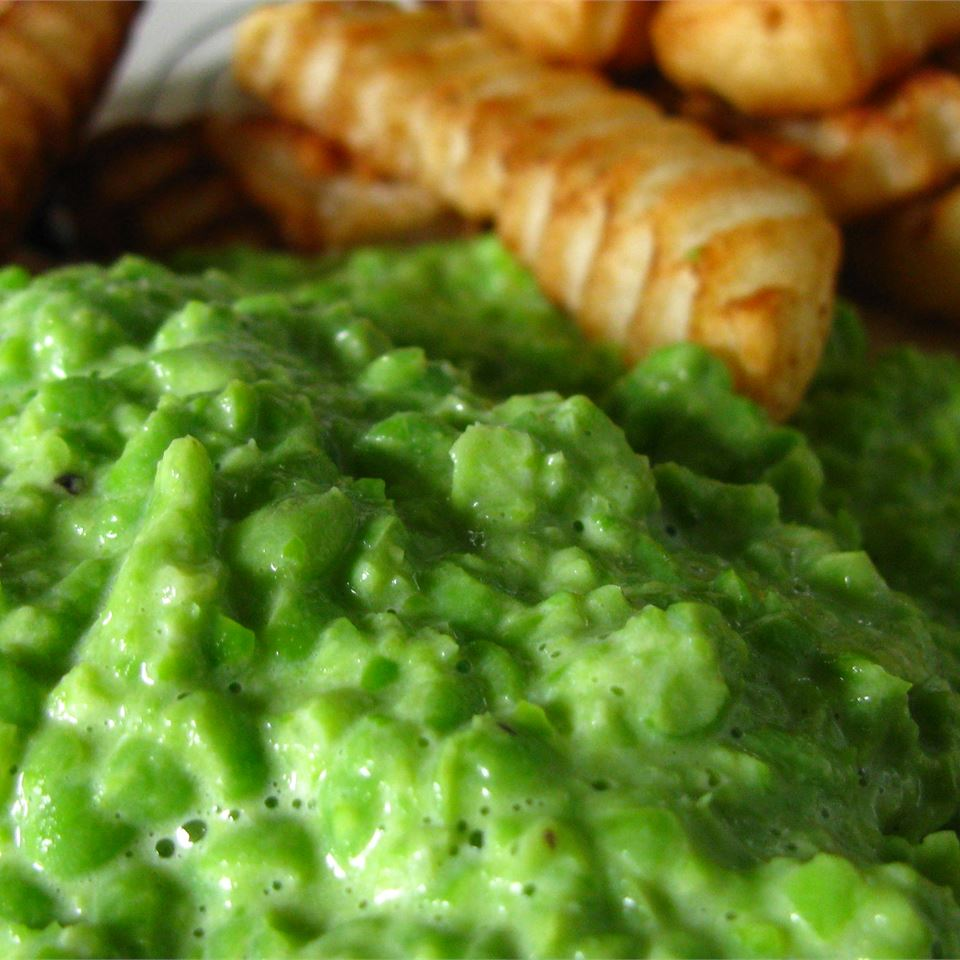 close up of mushy peas and fries