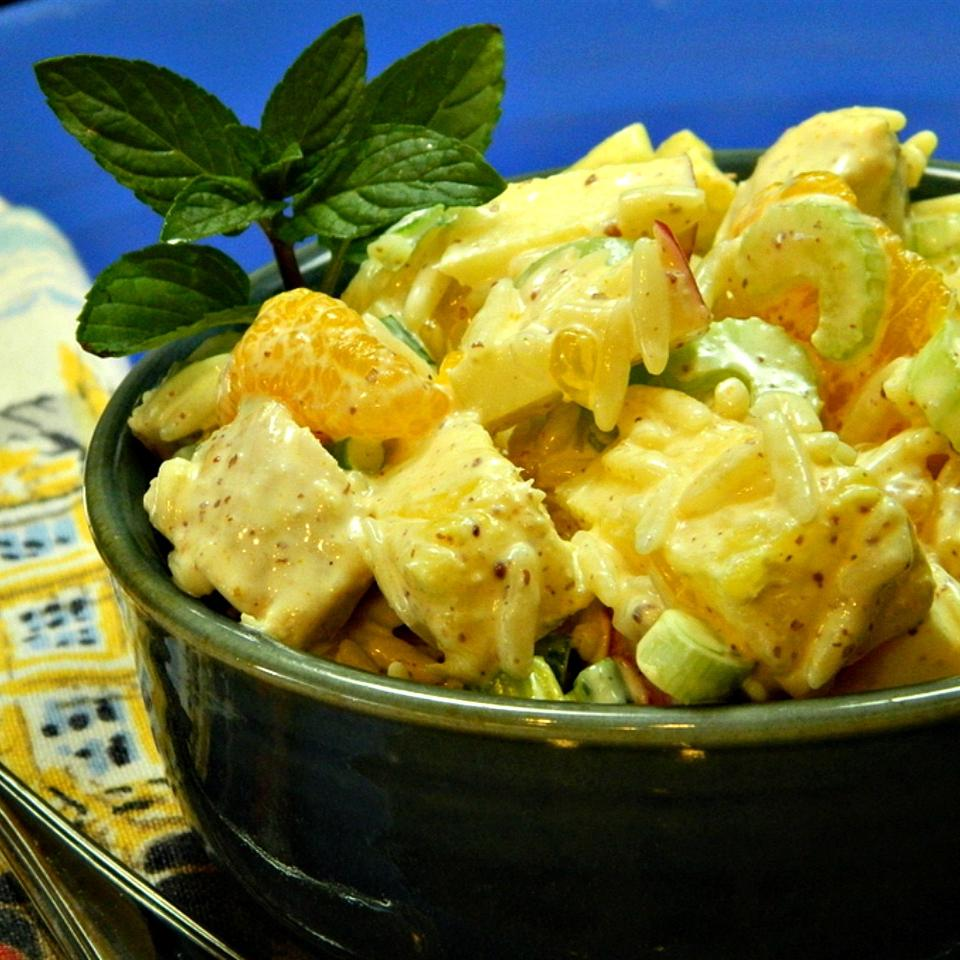 chicken salad with mandarins in green bowl