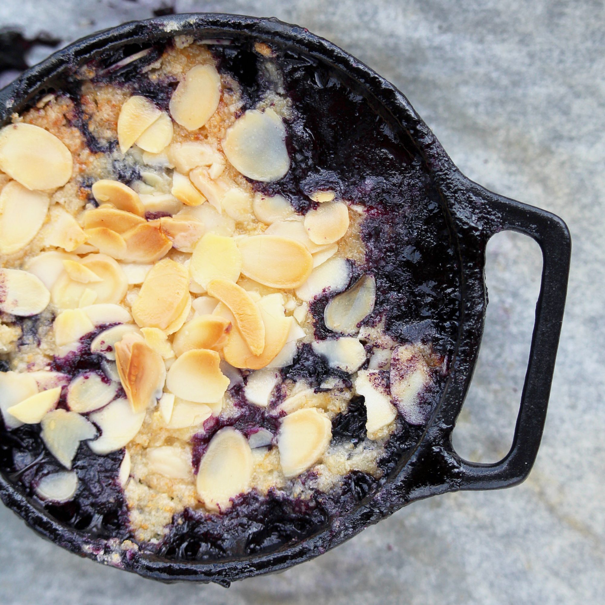 blueberry crumble in cast iron with nut topping