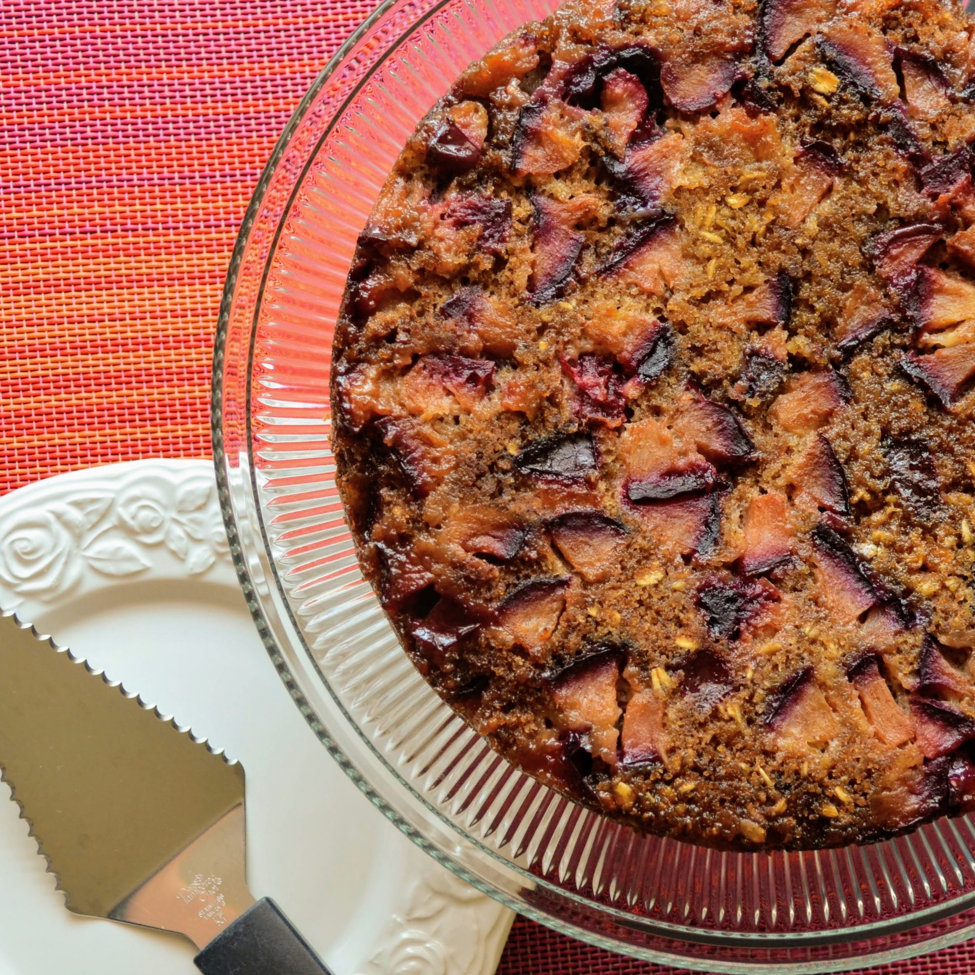 Spiced Plum Upside-Down Cake with Oats on a glass plate