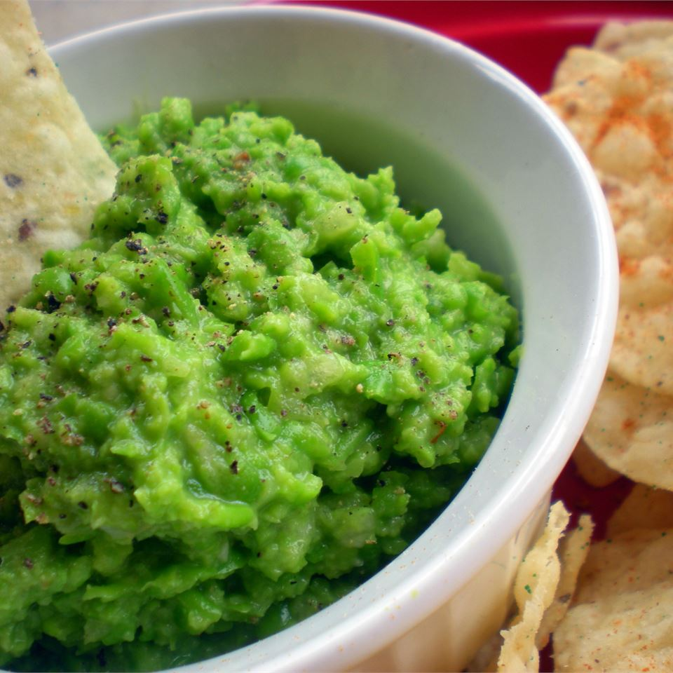 "bowl of mashed pea ""mockamole"" with corn chips"
