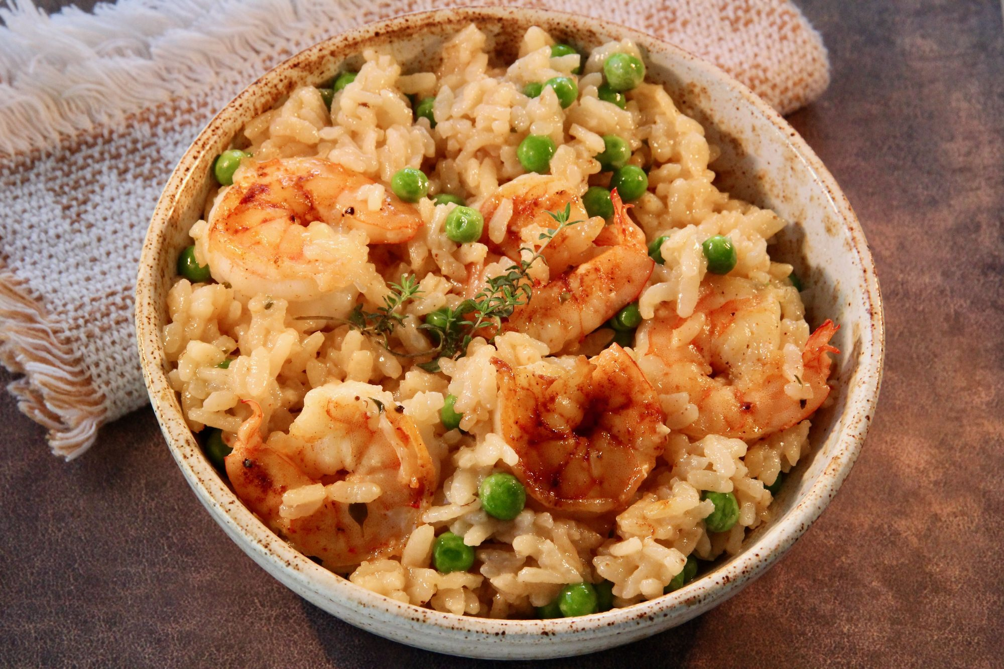 bowl of shrimp risotto with peas