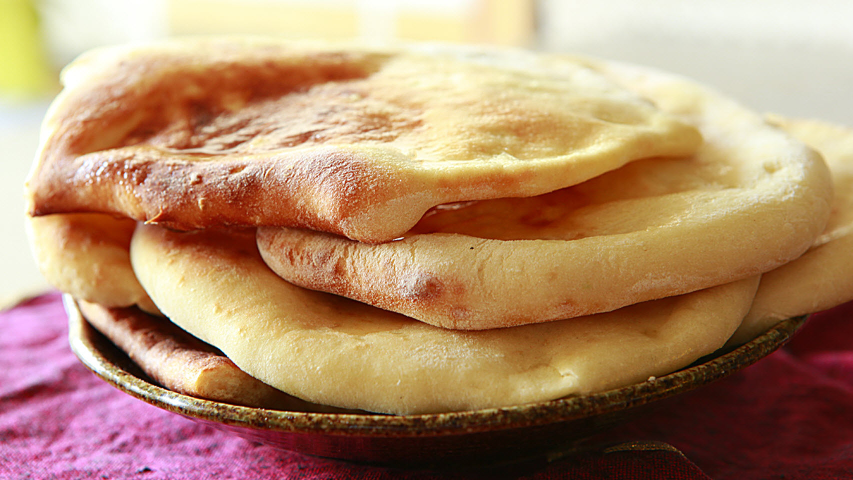 stack of homemade naan flatbreads