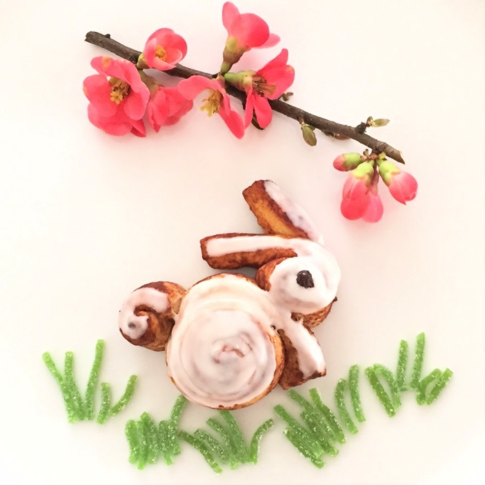 cinnamon roll bunny displayed with candy grass and flower blossoms