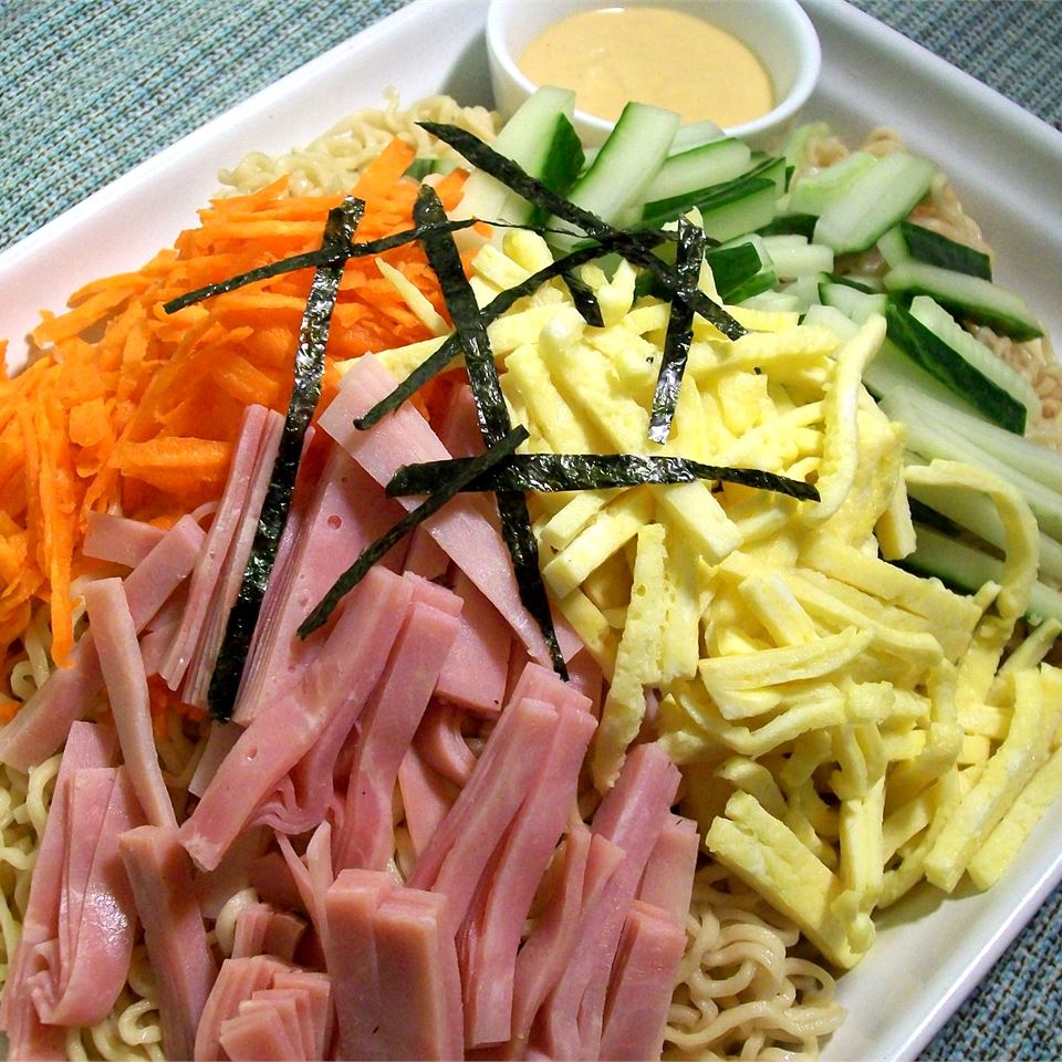 japanese noodles, ham, cucumbers on white plate