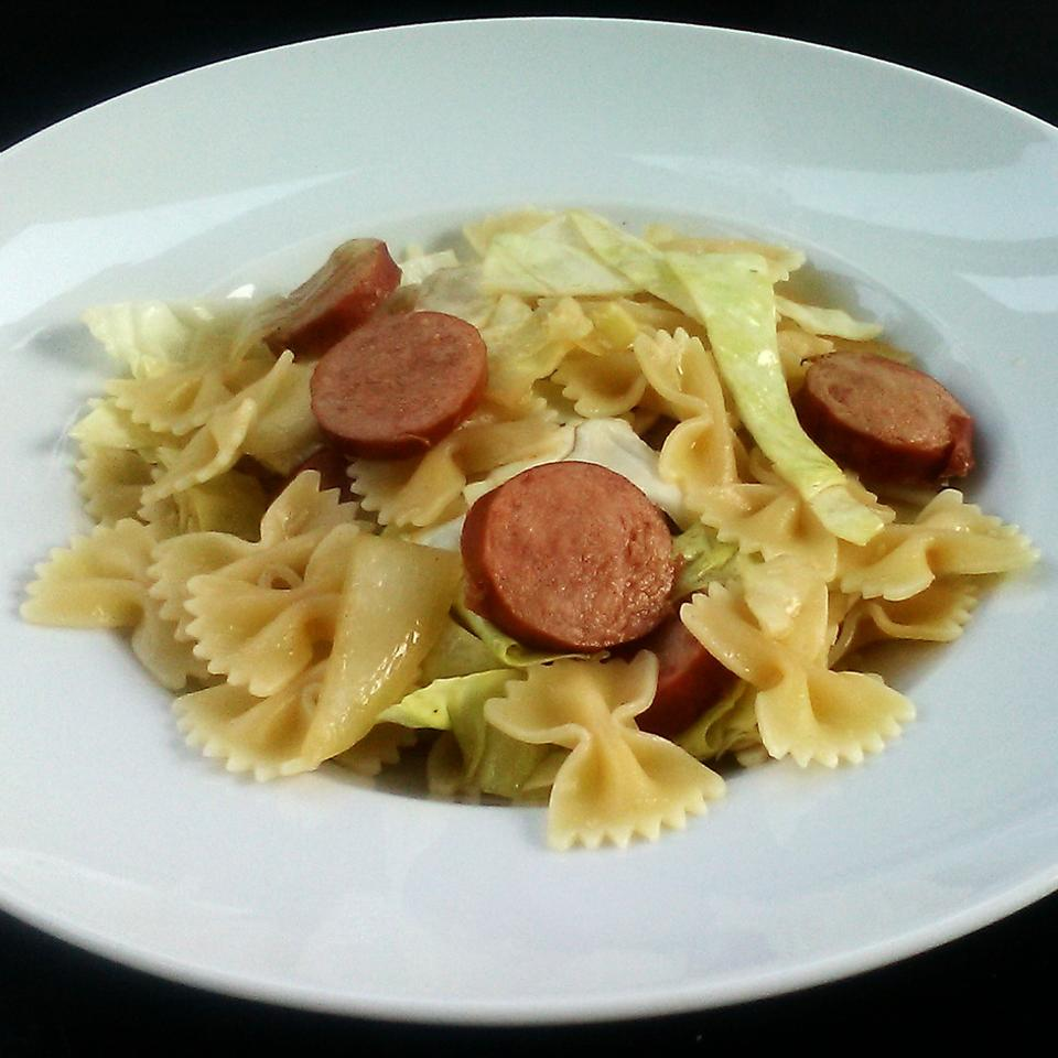 If you love cabbage and need another way to eat more of it, serve it up in this quick and easy pasta dinner. While the pasta cooks, you'll tenderize cabbage in butter, which becomes the sauce once the pasta and smoked sausage are added.