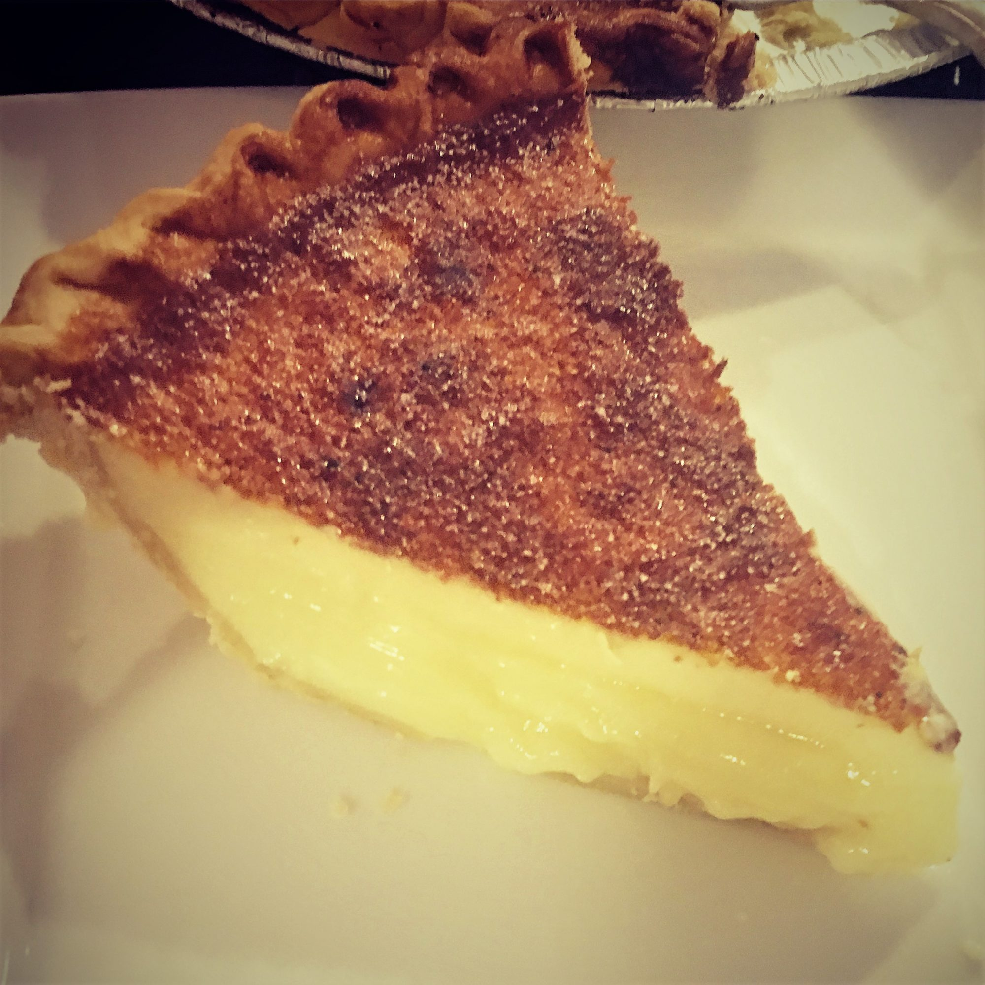 a slice of custard pie on a white plate