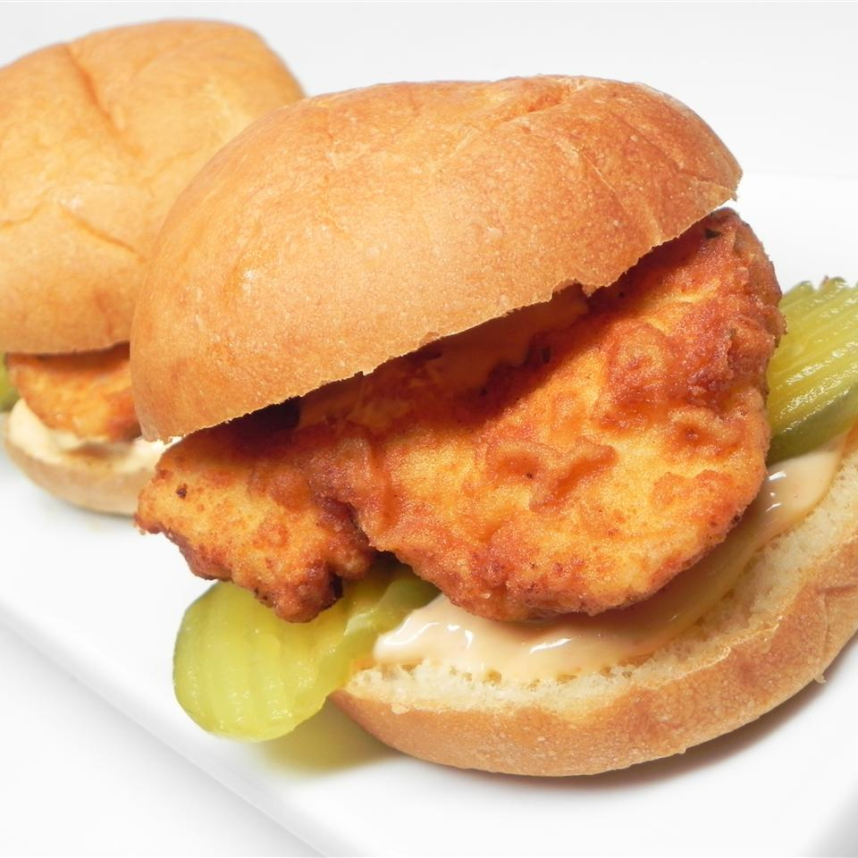 fried chicken sandwich with pickles on a bun